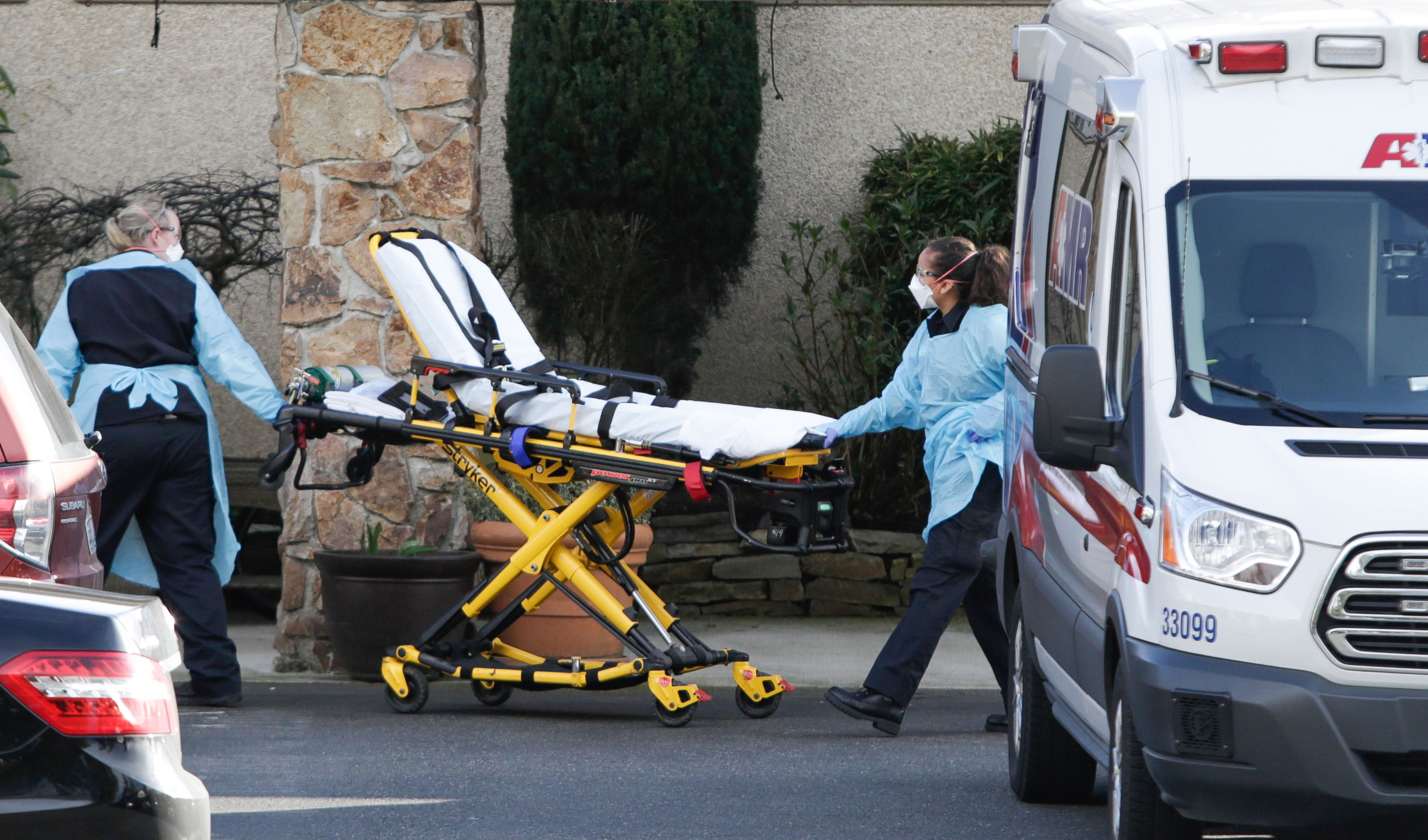 Medical workers take a stretcher into the Life Care Center of Kirkland in Washington on February 29.