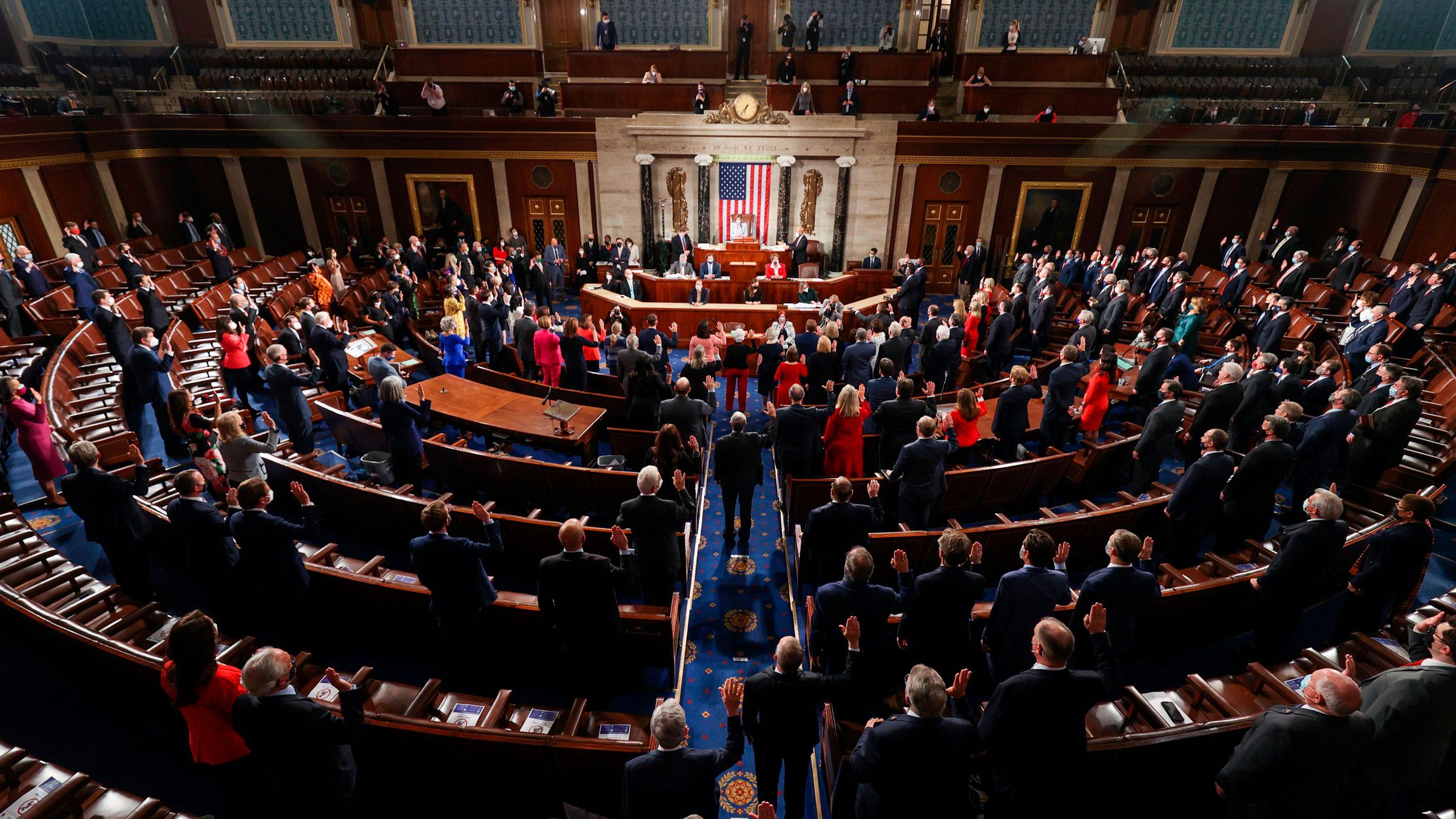 House Speaker Nancy Pelosi swears in new members of Congress on Sunday.