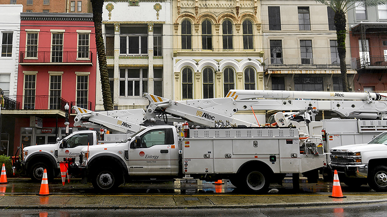Entergy Corp. electric utility company bucket trucks are staged on Canal Street in New Orleans, Louisiana on Sunday, August 29.