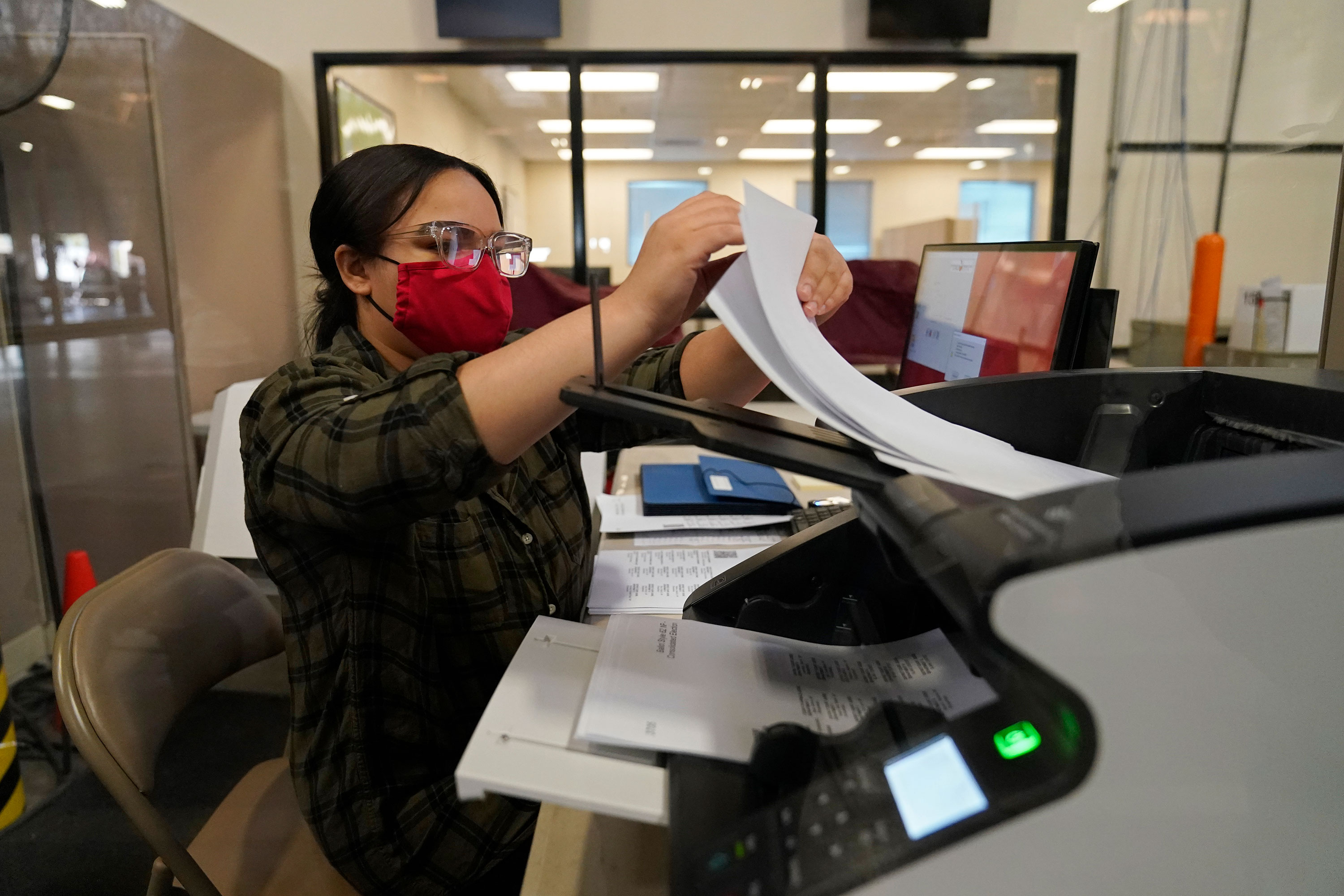 A county election worker scans ballots at a tabulating area at the Clark County Election Department in Las Vegas on November 4.