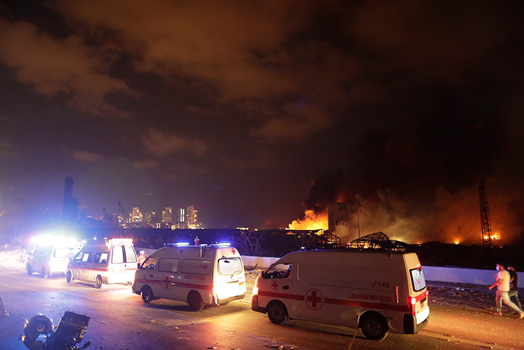 Ambulances drive past the site of the explosion.