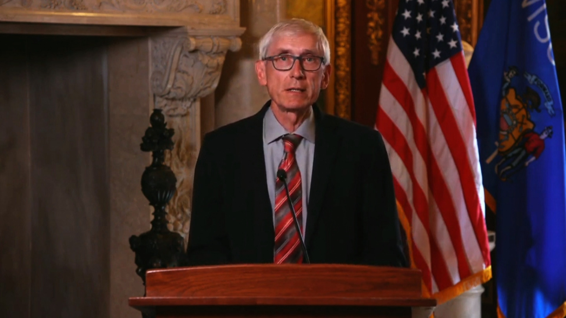 Wisconsin Gov. Tony Evers delivers a statement in Madison, Wisconsin, on August 24.