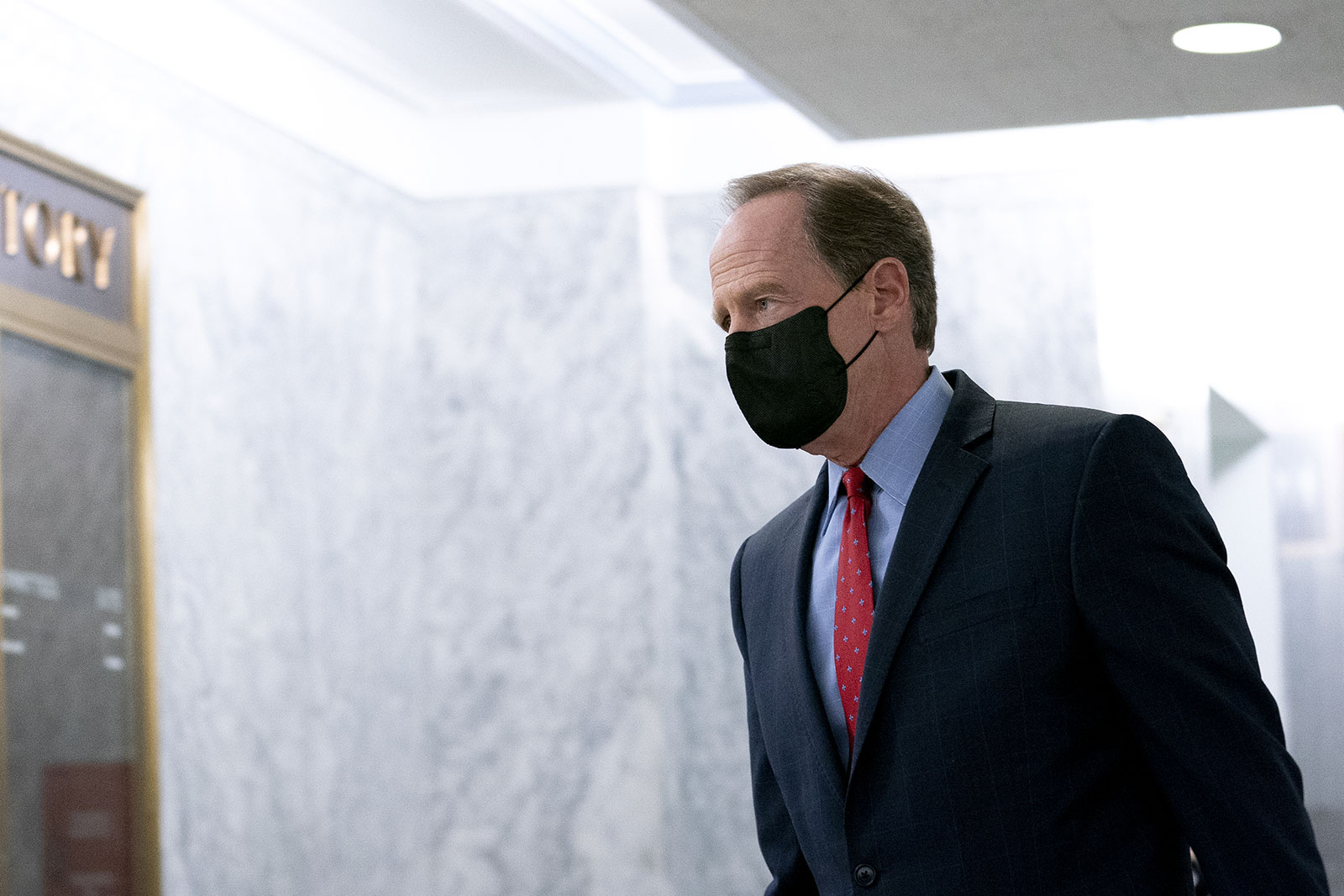 Sen. Pat Toomey walks through the Hart Senate Office Building in Washington, DC, on November 12.