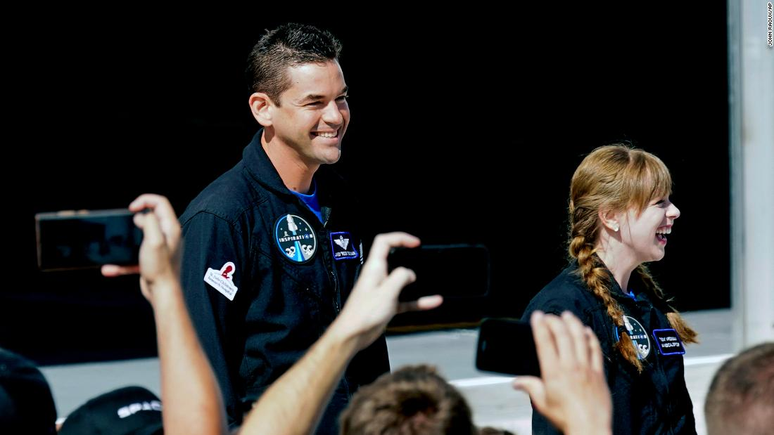 Jared Isaacman, left, and Hayley Arceneaux prepare to head to launchpad 39A for a launch on a SpaceX Falcon 9 at the Kennedy Space Center in Cape Canaveral, Fla., Wednesday Sept. 15, 2021.
