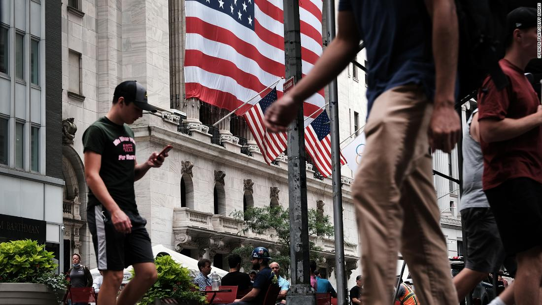 People walk by the New York Stock Exchange on August 10, 2021 in New York City.