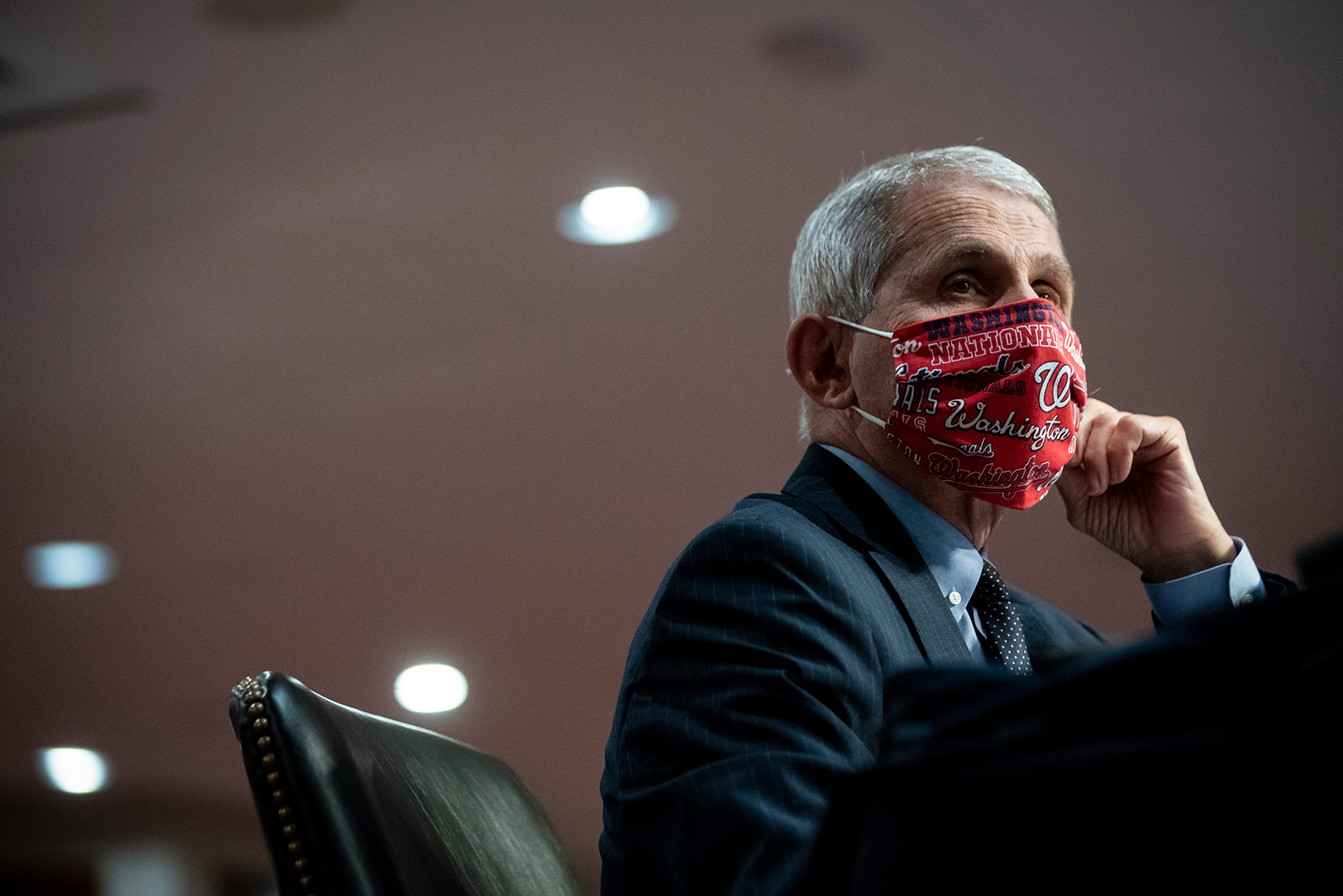 Dr. Anthony Fauci, director of the National Institute of Allergy and Infectious Diseases, wears a face covering as he listens during a Senate Health, Education, Labor and Pensions Committee hearing on June 30, in Washington.