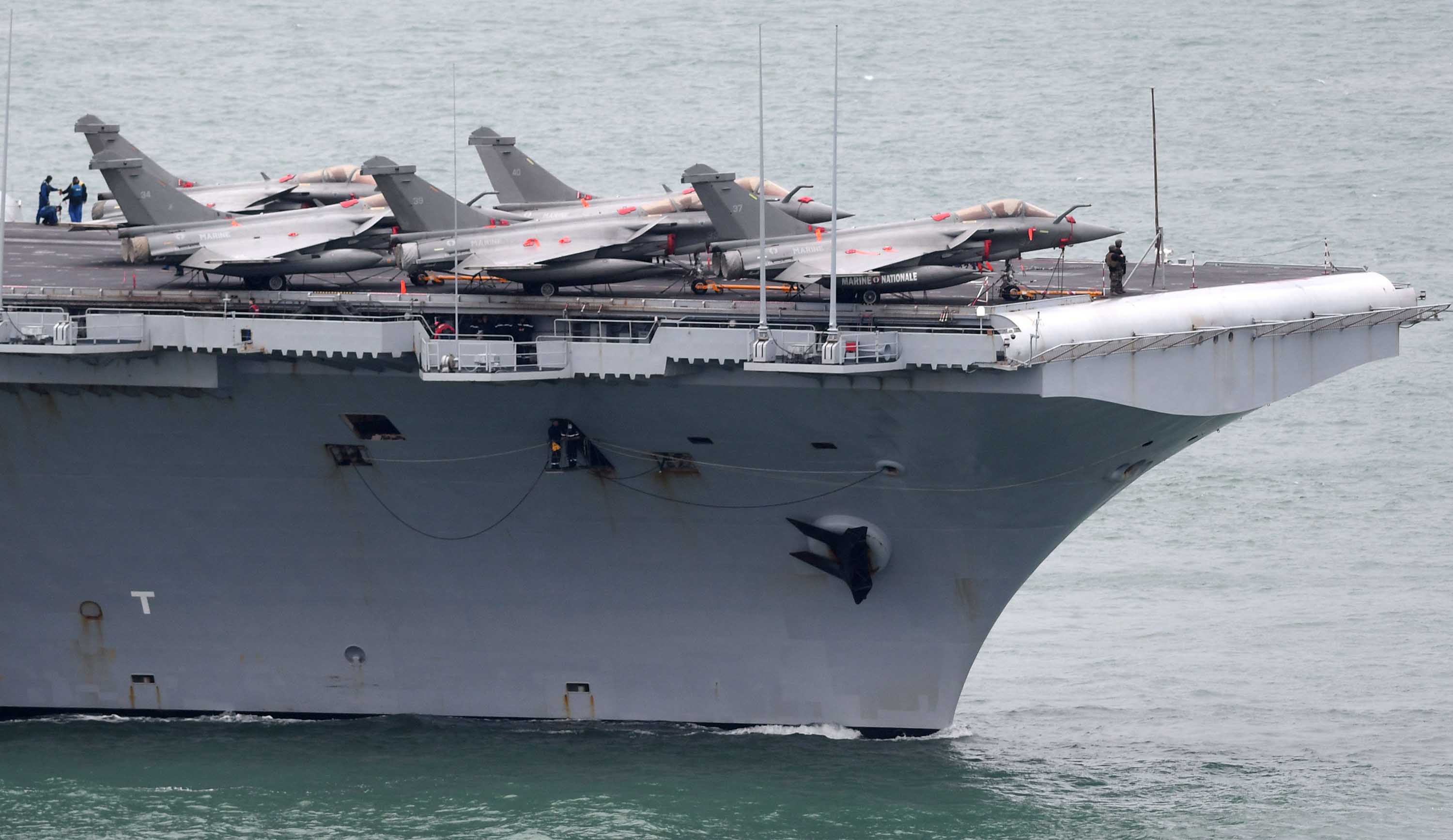 The French aircraft carrier Charles de Gaulle enters the port of Brest, France on March 13.