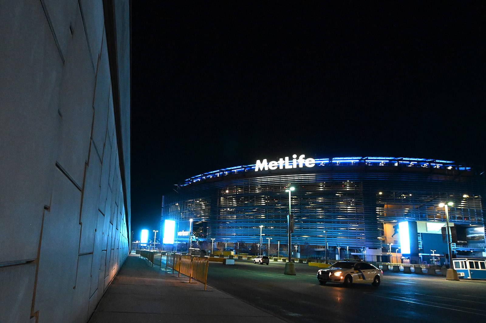 MetLife Stadium, where the Giants and the Jets play, is illuminated in blue to honor essential workers on April 9 in East Rutherford, New Jersey.
