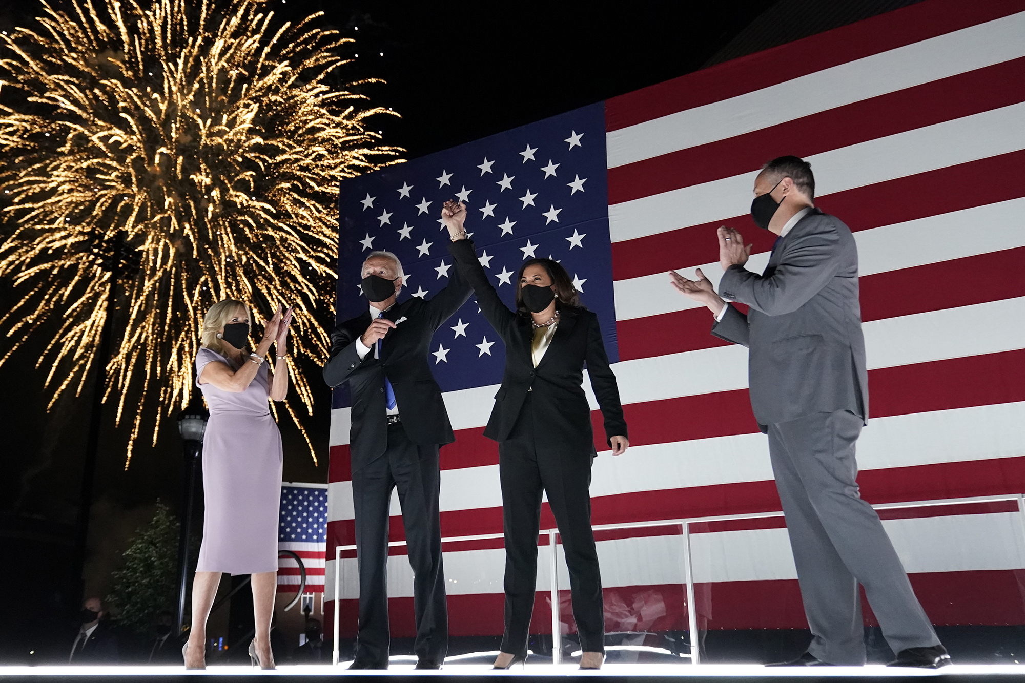 Democratic presidential candidate former Vice President Joe Biden, and his wife Jill Biden, watch fireworks with Democratic vice presidential candidate Sen. Kamala Harris, and her husband Doug Emhoff, during the fourth day of the Democratic National Convention, Thursday, August 20 at the Chase Center in Wilmington, Delaware.