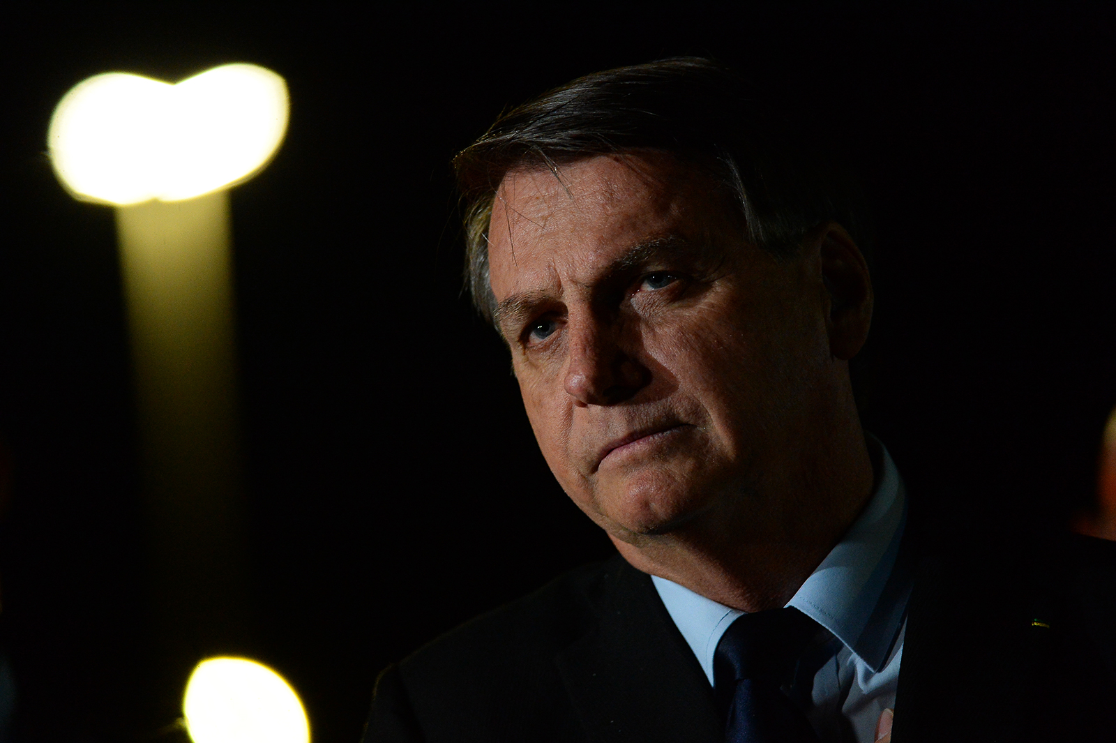 President of Brazil Jair Bolsonaro reacts during a conference with the press and supporters at Alvorada Palace on June 5,  in Brasilia, Brazil.
