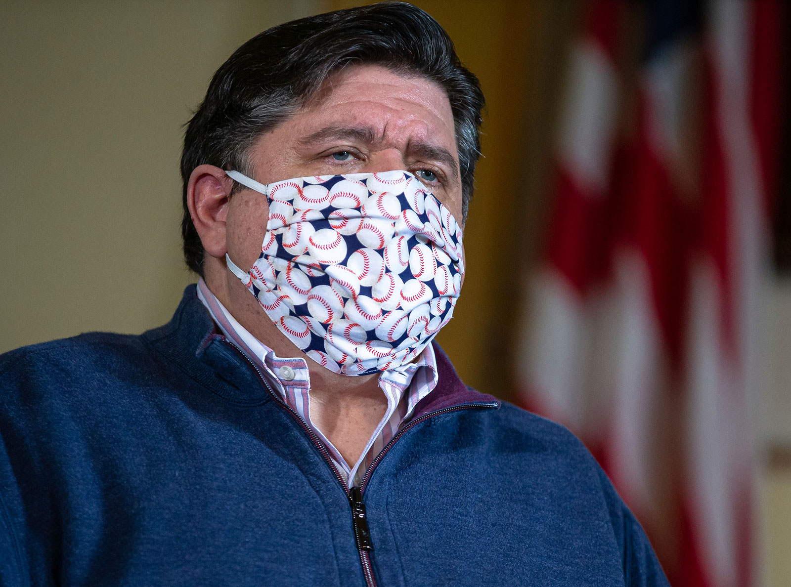 Illinois Gov. J.B. Prtizker wears a mask during a press briefing on May 21.