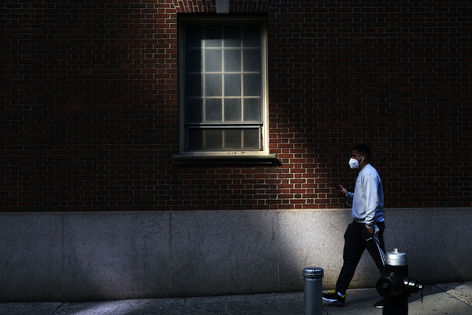 A man walks through the Financial District on May 11, in New York City.