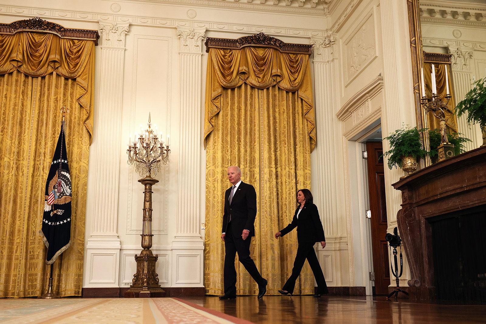 President Joe Biden and Vice President Kamala Harris arrive in the East Room of the White House on May 17.