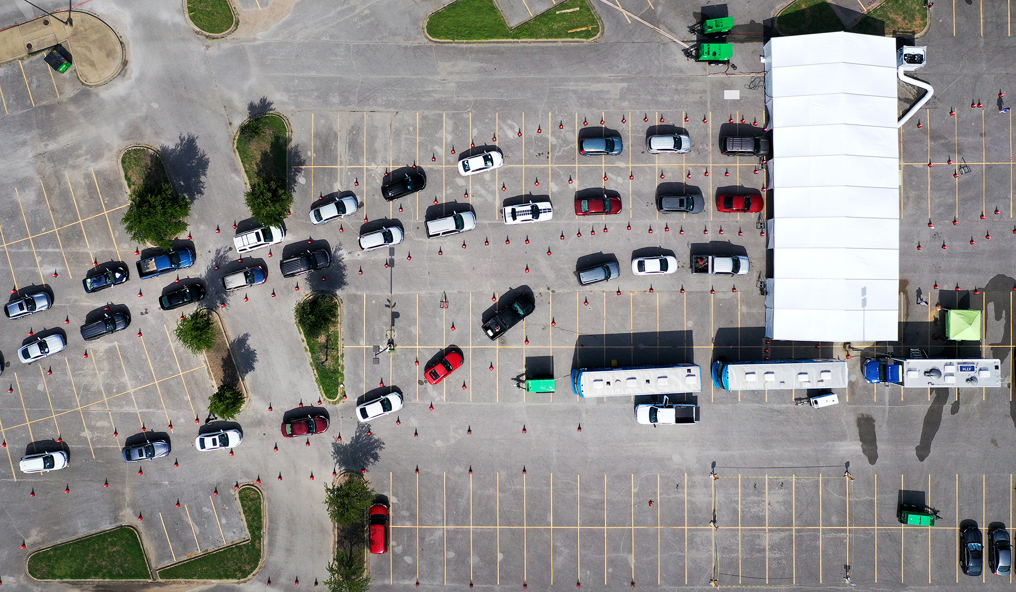 An aerial view from a drone as residents wait in line for the drive-thru COVID-19 testing center at the Ellis Davis Field House on July 2, 2020 in Dallas, Texas.