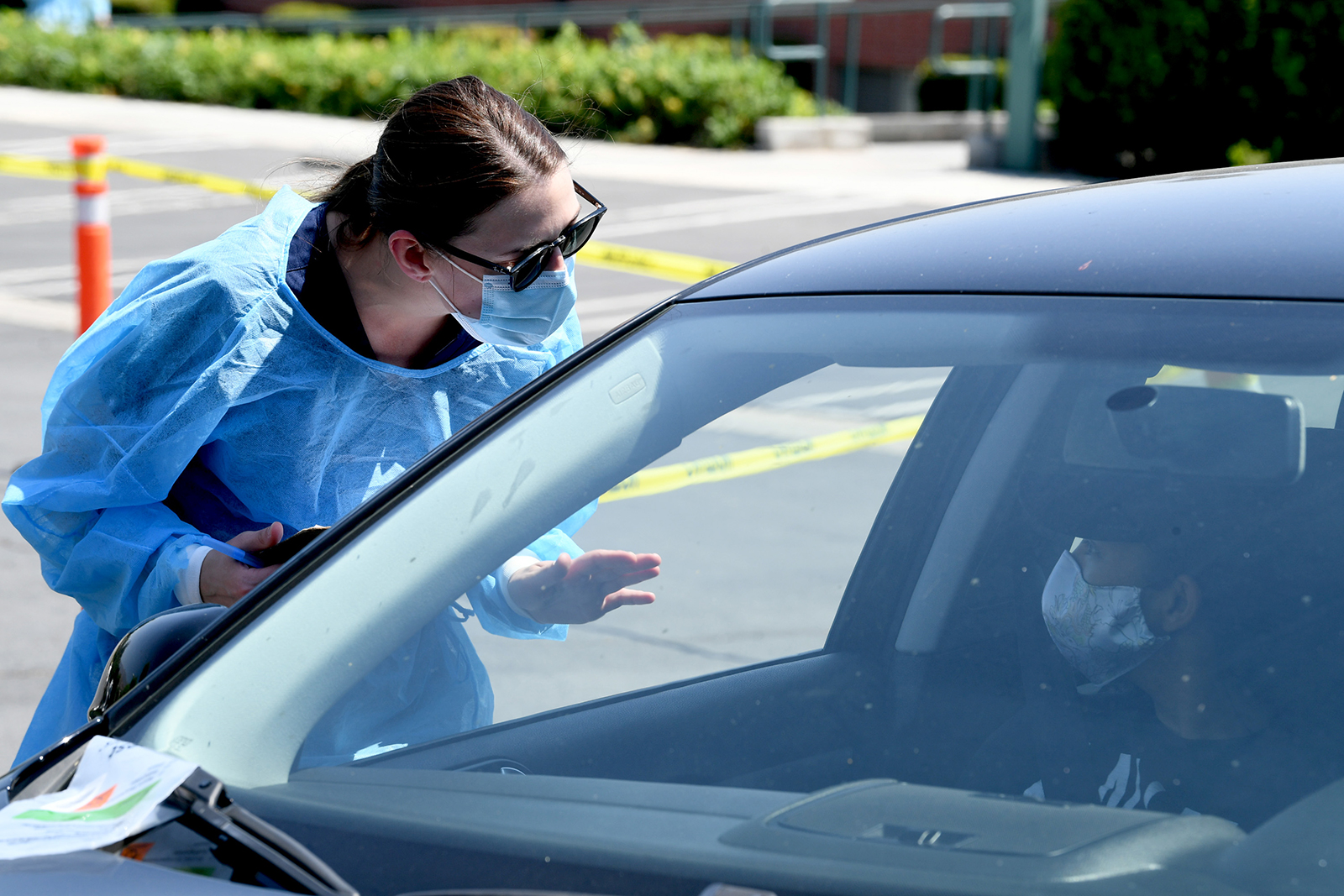 Urgent care workers wearing personal protective equipment perform drive-up Covid-19 testing for students and faculty on the first day of school at Woodbury University in Burbank, California on August 24.