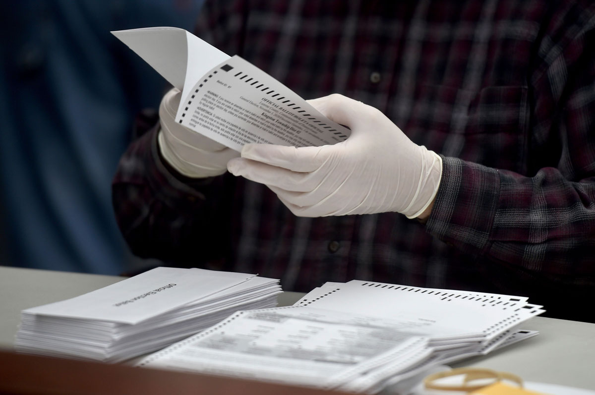 A county employee opens a mail in ballots at the Luzerne County Bureau of Elections in Pennsylvania on November 3.