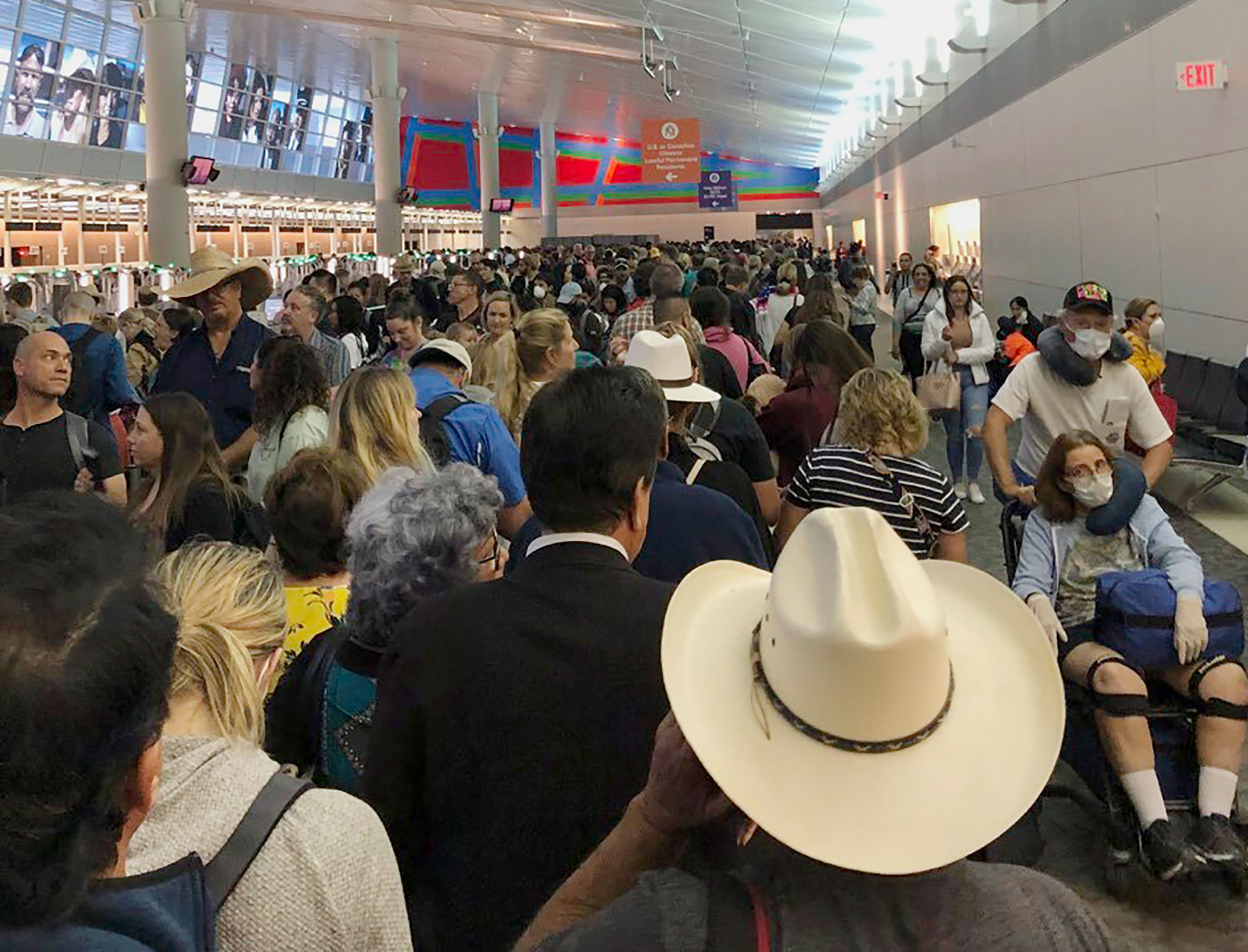 People wait in line to go through the customs at Dallas Fort Worth International Airport in Grapevine, Texas, on March 14.