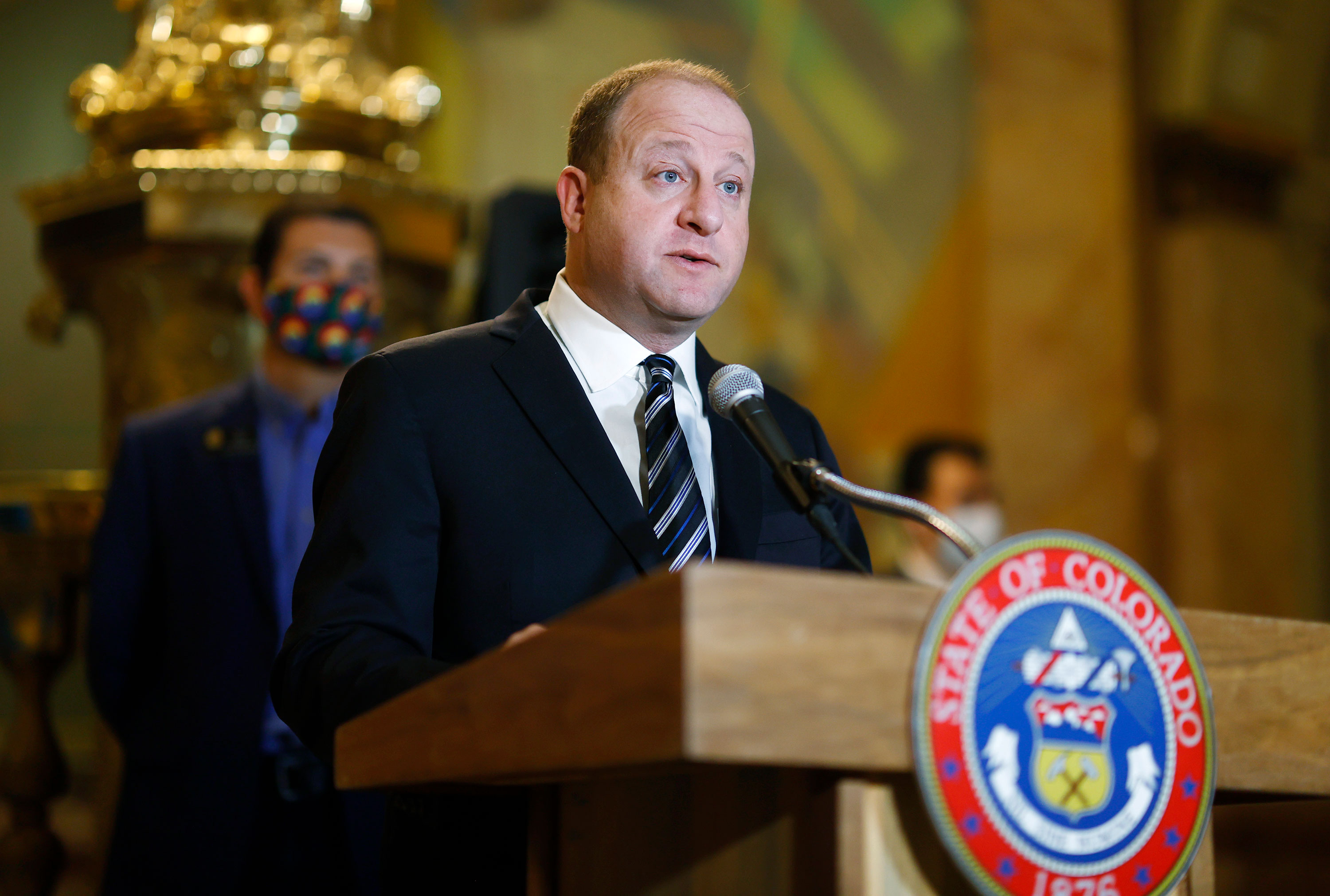 Colorado Gov. Jared Polis speaks before signing a police accountability bill on Friday, June 19 in Denver.