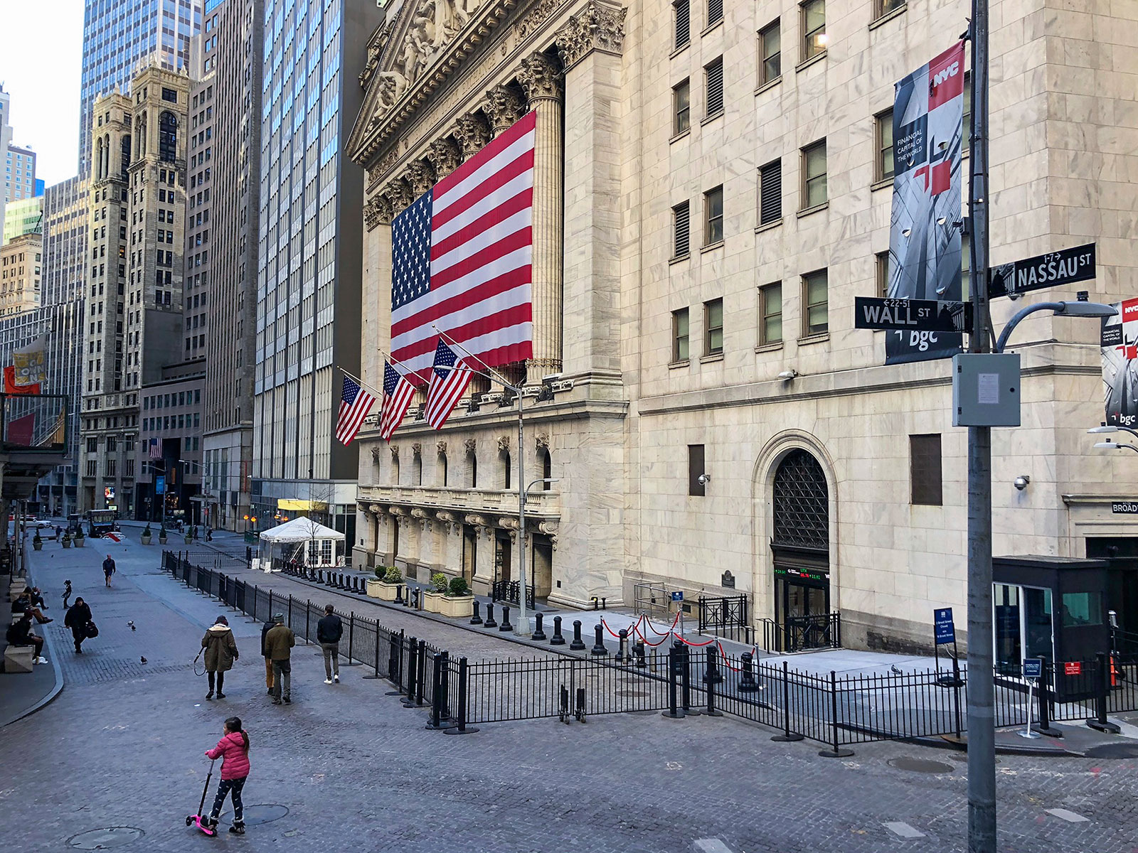 People walk in front of the New York Stock Exchange on March 24.