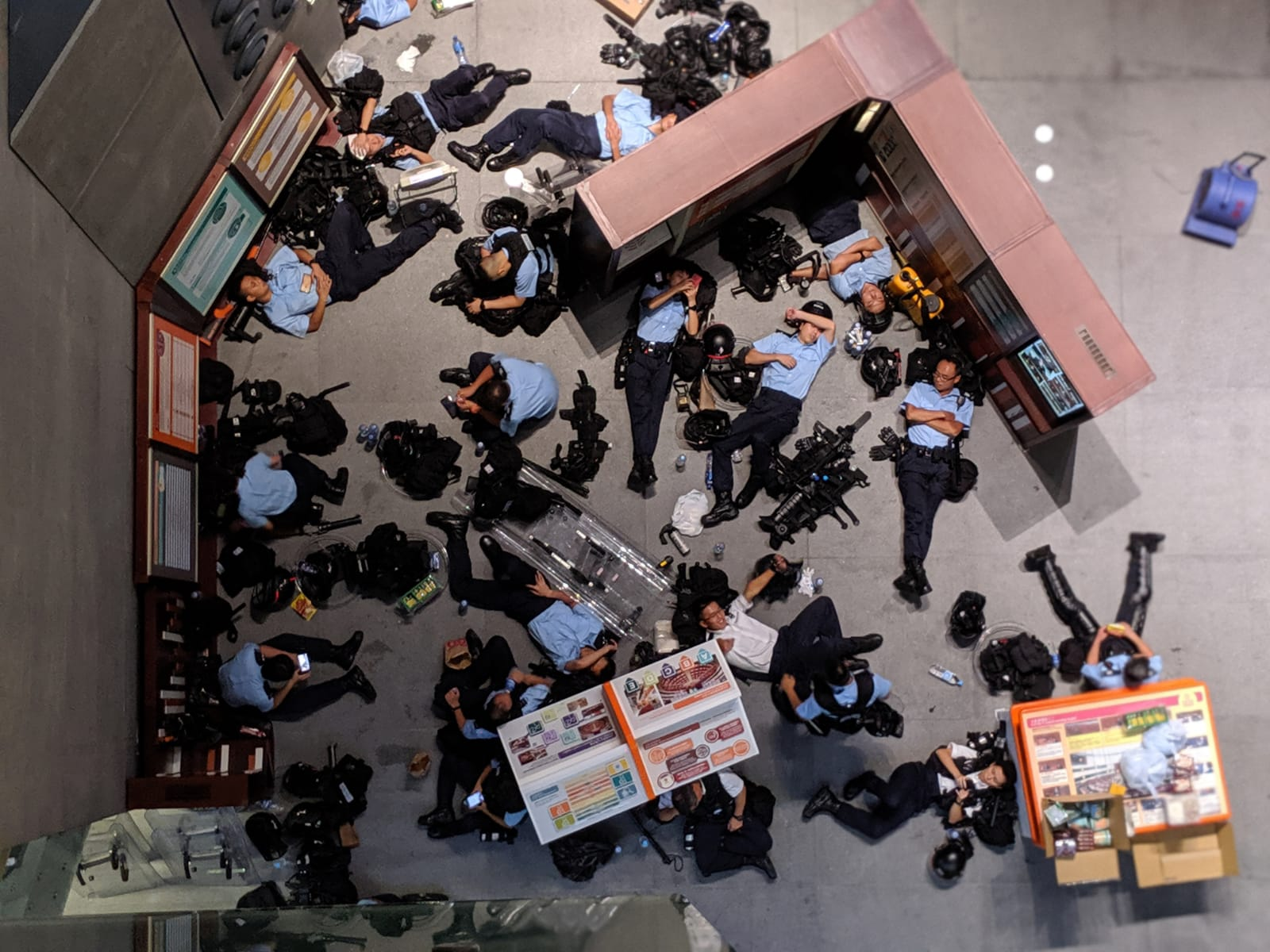 Police officers take rest in the Legislative Council building.