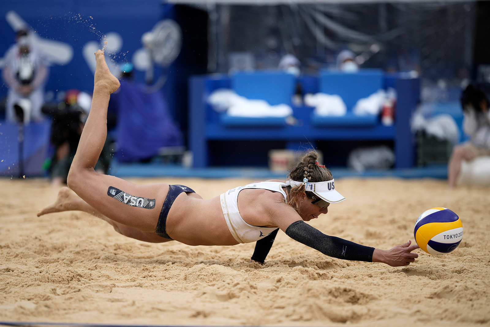 America's April Ross dives for the ball during a beach volleyball match against the Netherlands on Friday.