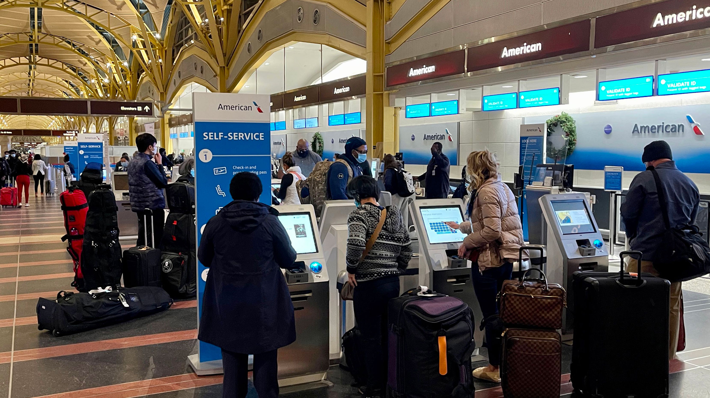 People check in at Washington Reagan National Airport on December 18 in Arlington, Virginia.