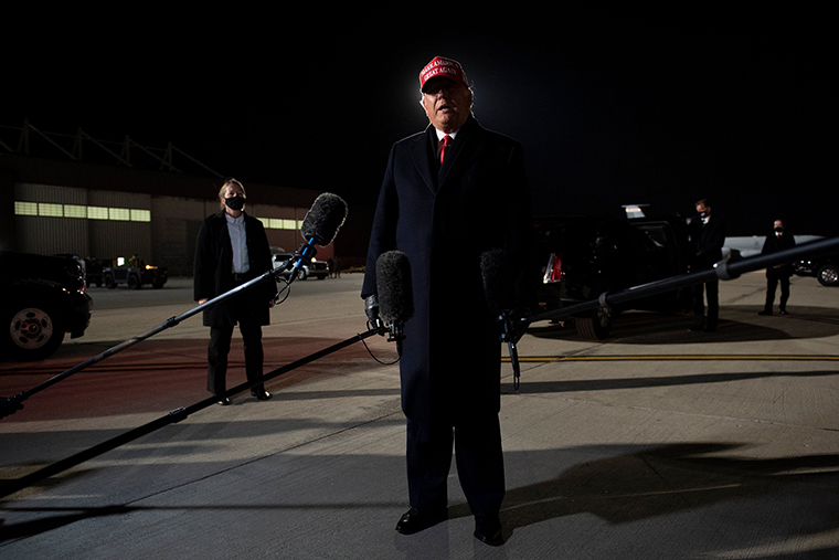President Donald Trump speaks to the press at General Mitchell International Airport, on Monday,  November 2, in Milwaukee, Wisconsin.