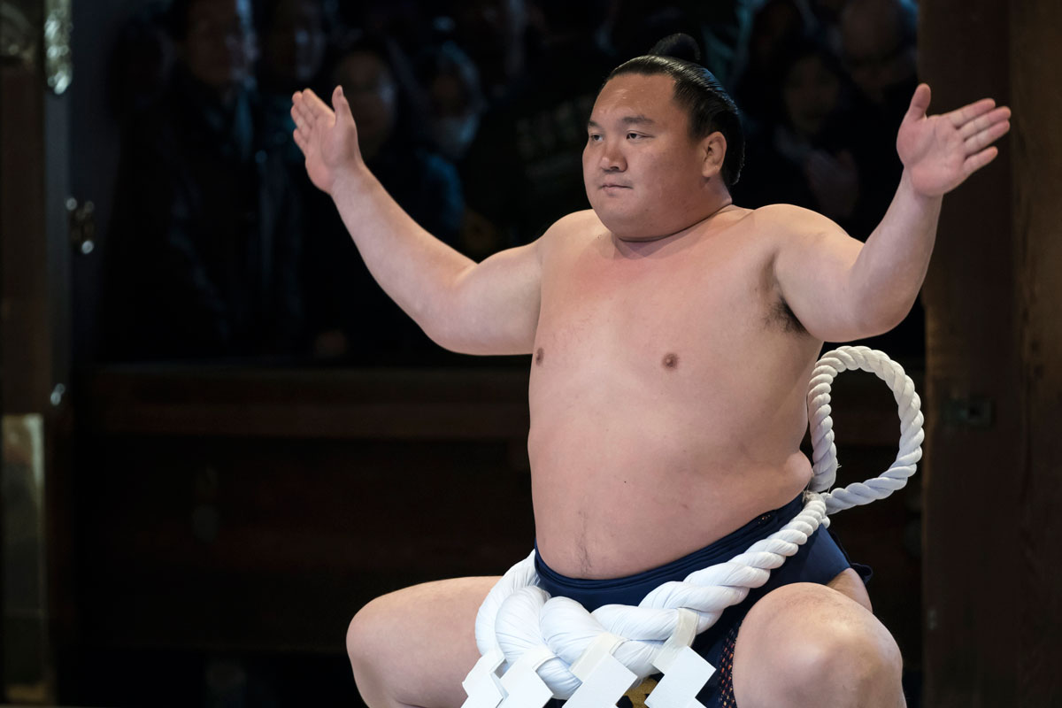 Mongolian-born grand sumo champion Sho Hakuho performs a kata during a ring-entering ceremony at the Meiji Jingu Shrine on January 7, 2020 in Tokyo, Japan.