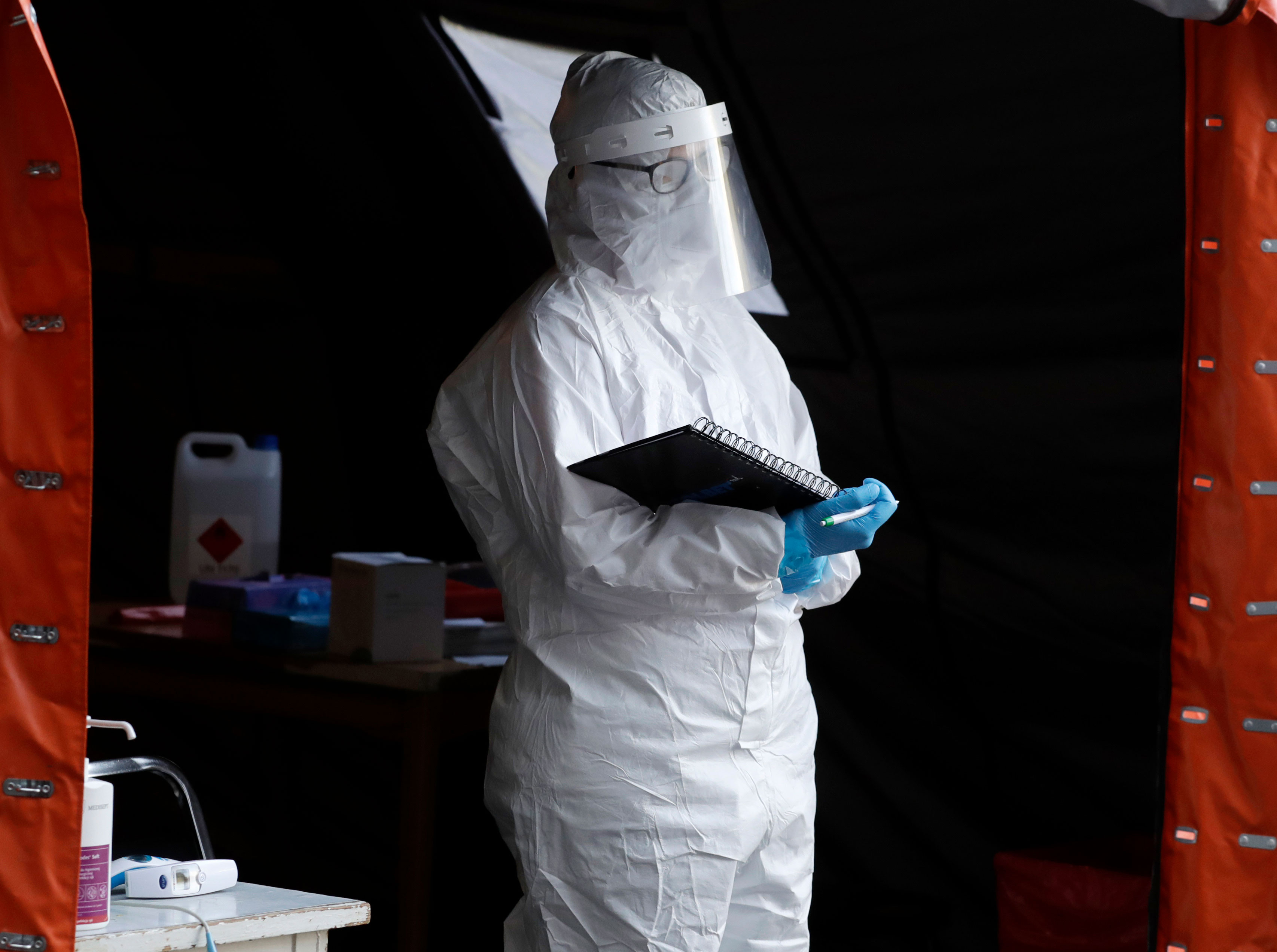 A medical worker in Warsaw, Poland, waits at a Covid-19 testing center on October 22.