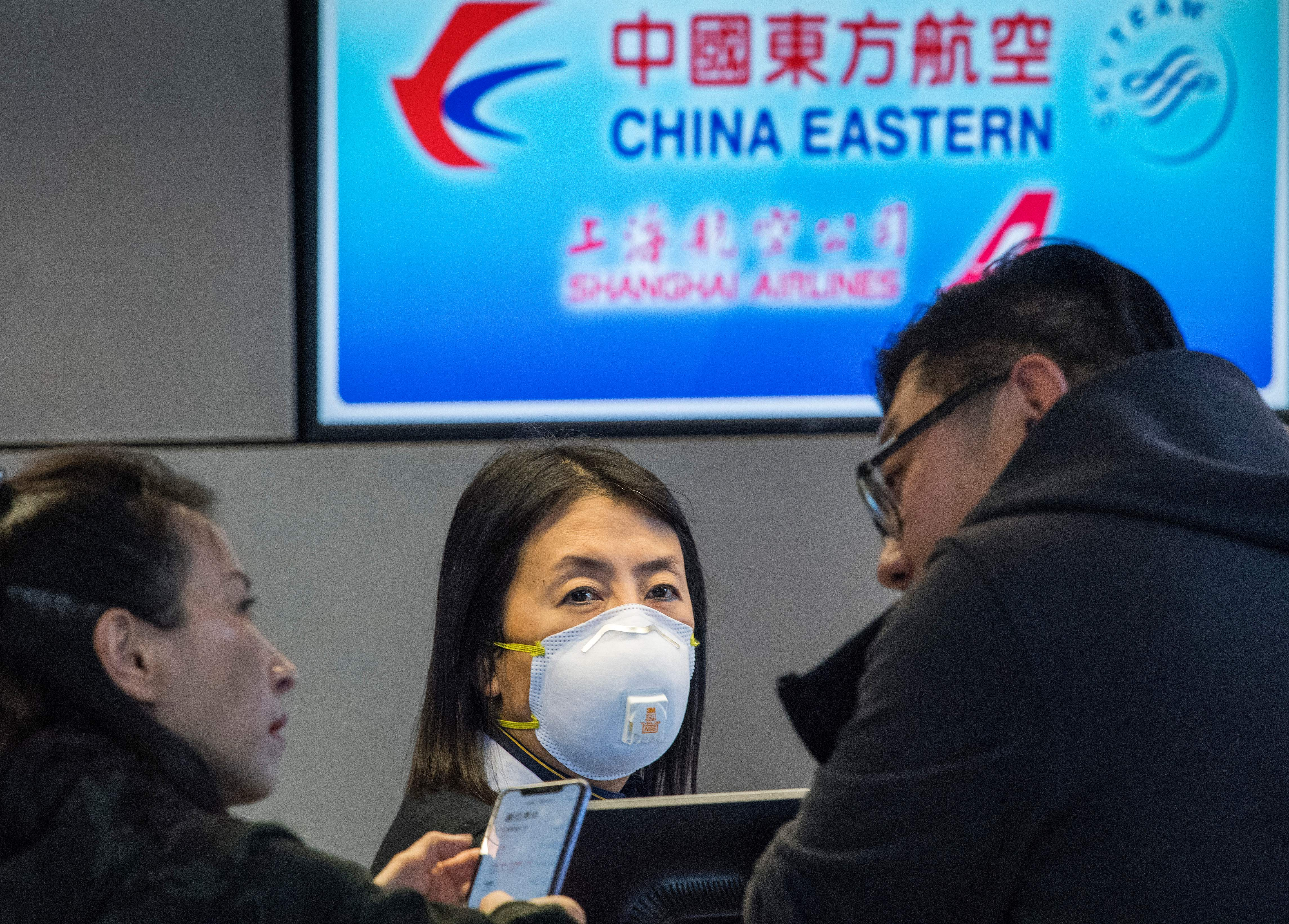 Passengers wait for standby tickets on a China Eastern flight to Shanghai, at Los Angeles International Airport on Sunday.
