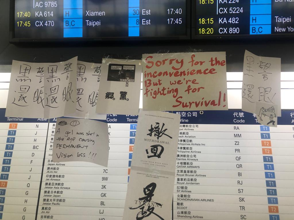 Graffiti and posters are plastered over Hong Kong's airport.
