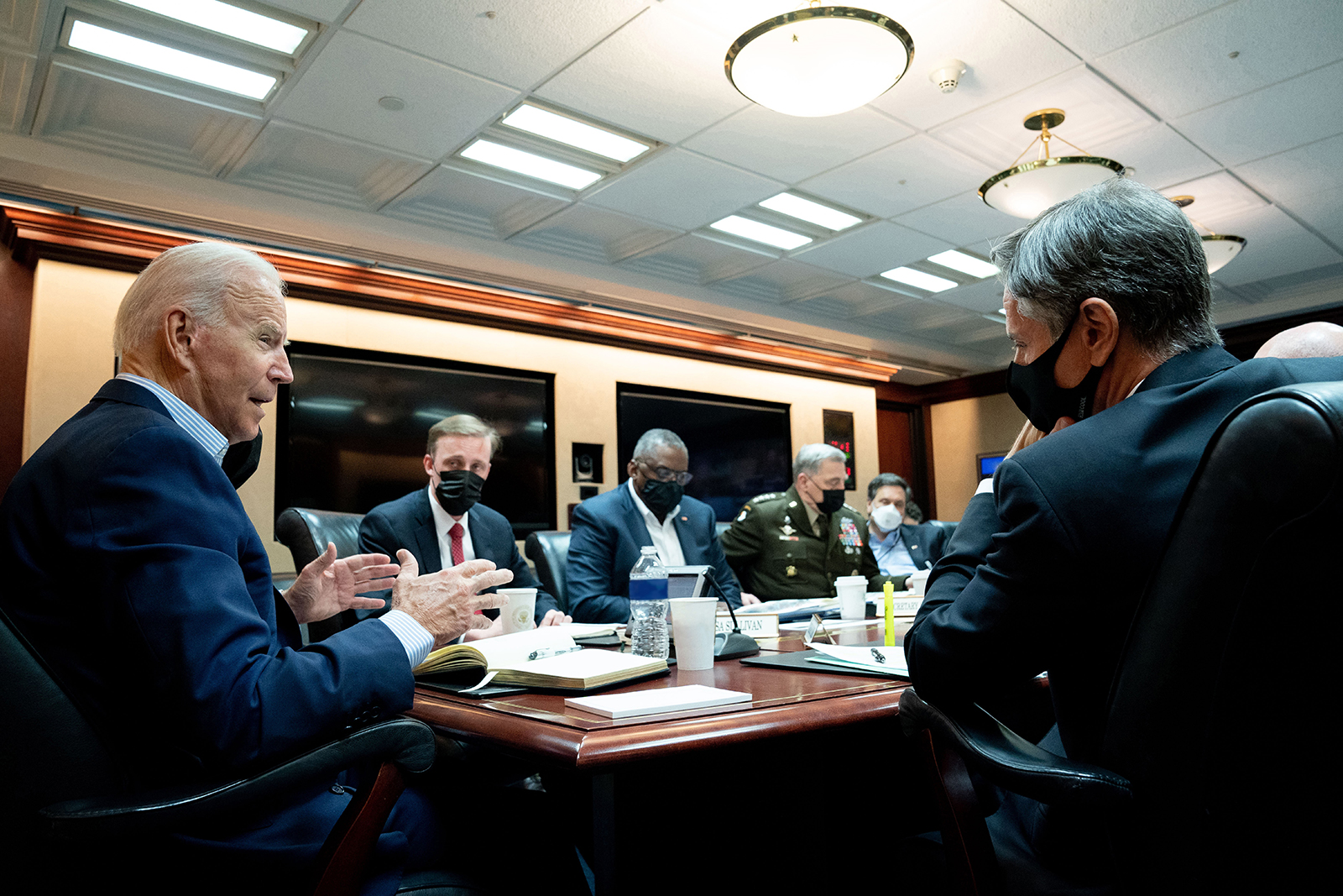In this handout photo provided by the White House, President Joe Biden meets with his national security team for an operational update on the situation in Afghanistan on August 22 at the White House in Washington. They discussed the security situation in Afghanistan and counterterrorism operations, including ISIS-K.