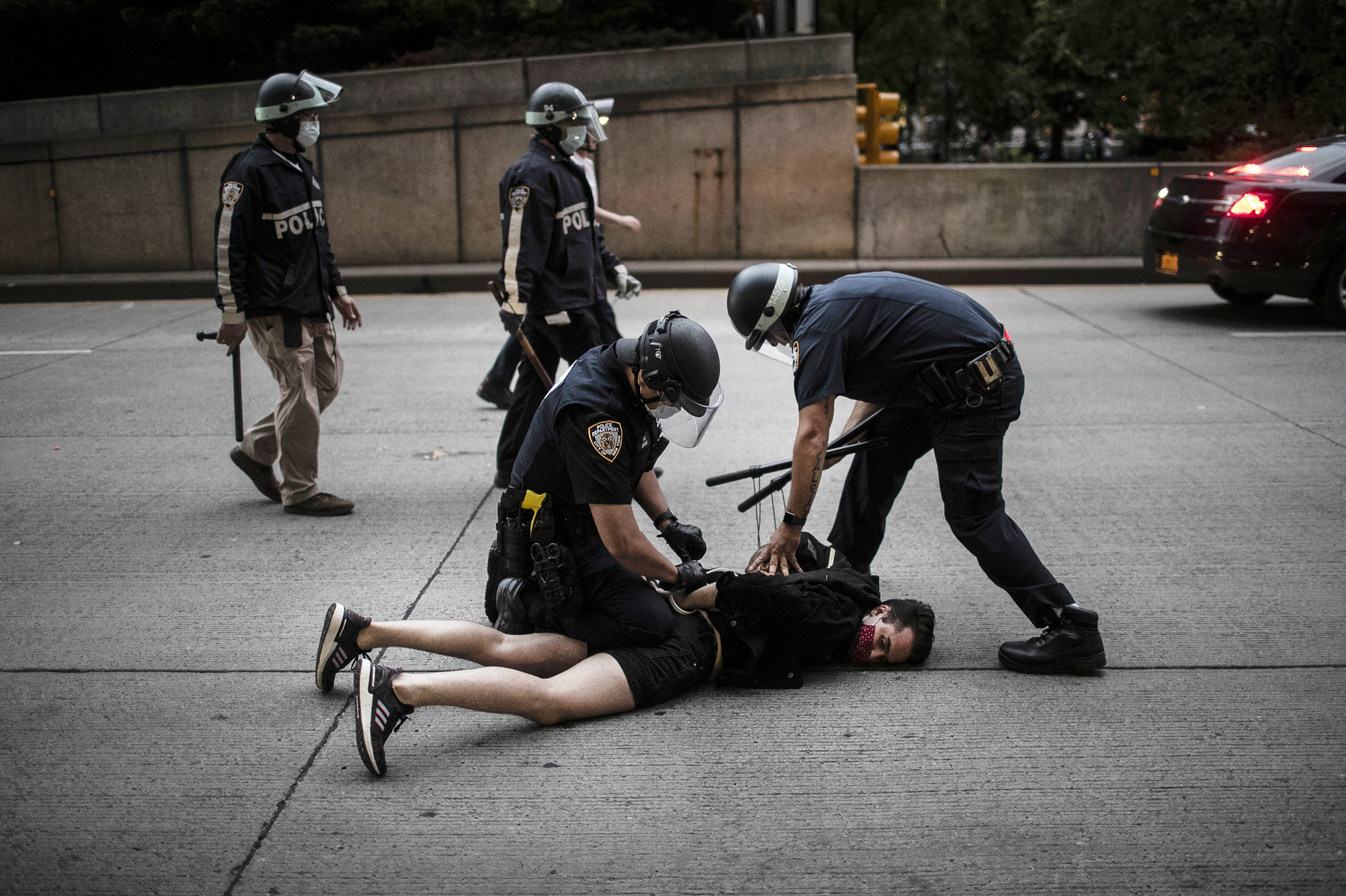 Police detain a protester who declined to get off the streets during curfew in New York, on Tuesday, June 2.