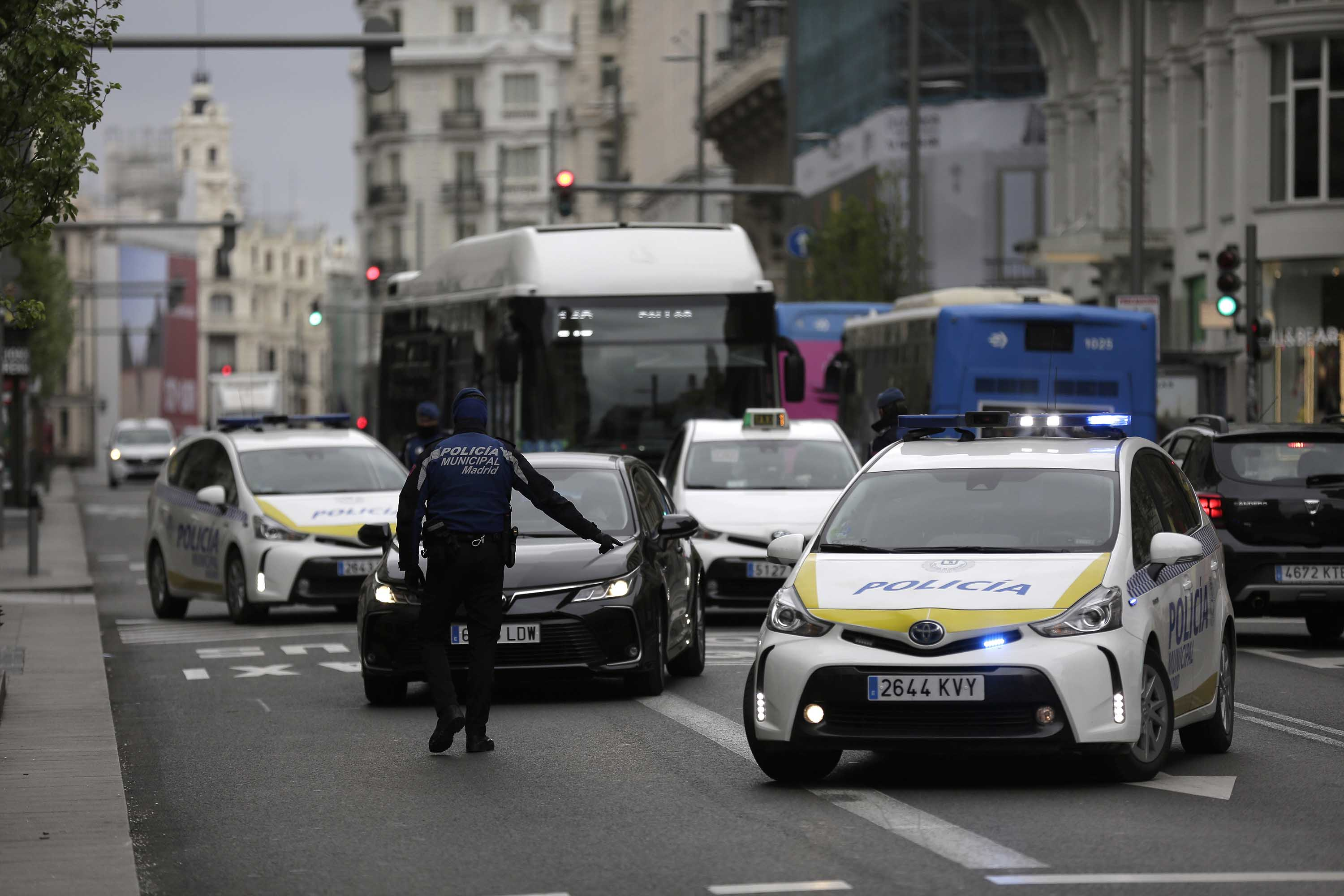 Police officers stop a car at a control point in Madrid, Spain, on March 20.