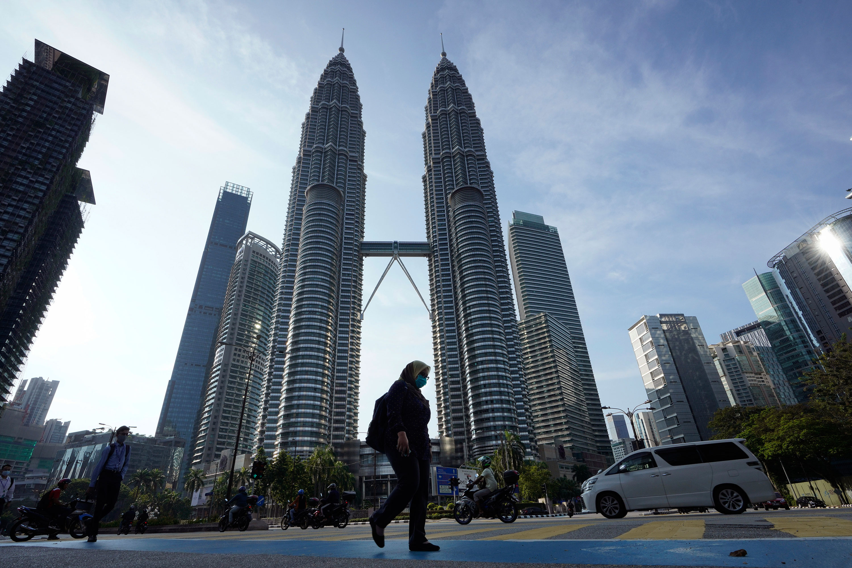 Pedestrians walk through Kuala Lumpur, Malaysia on Wednesday.