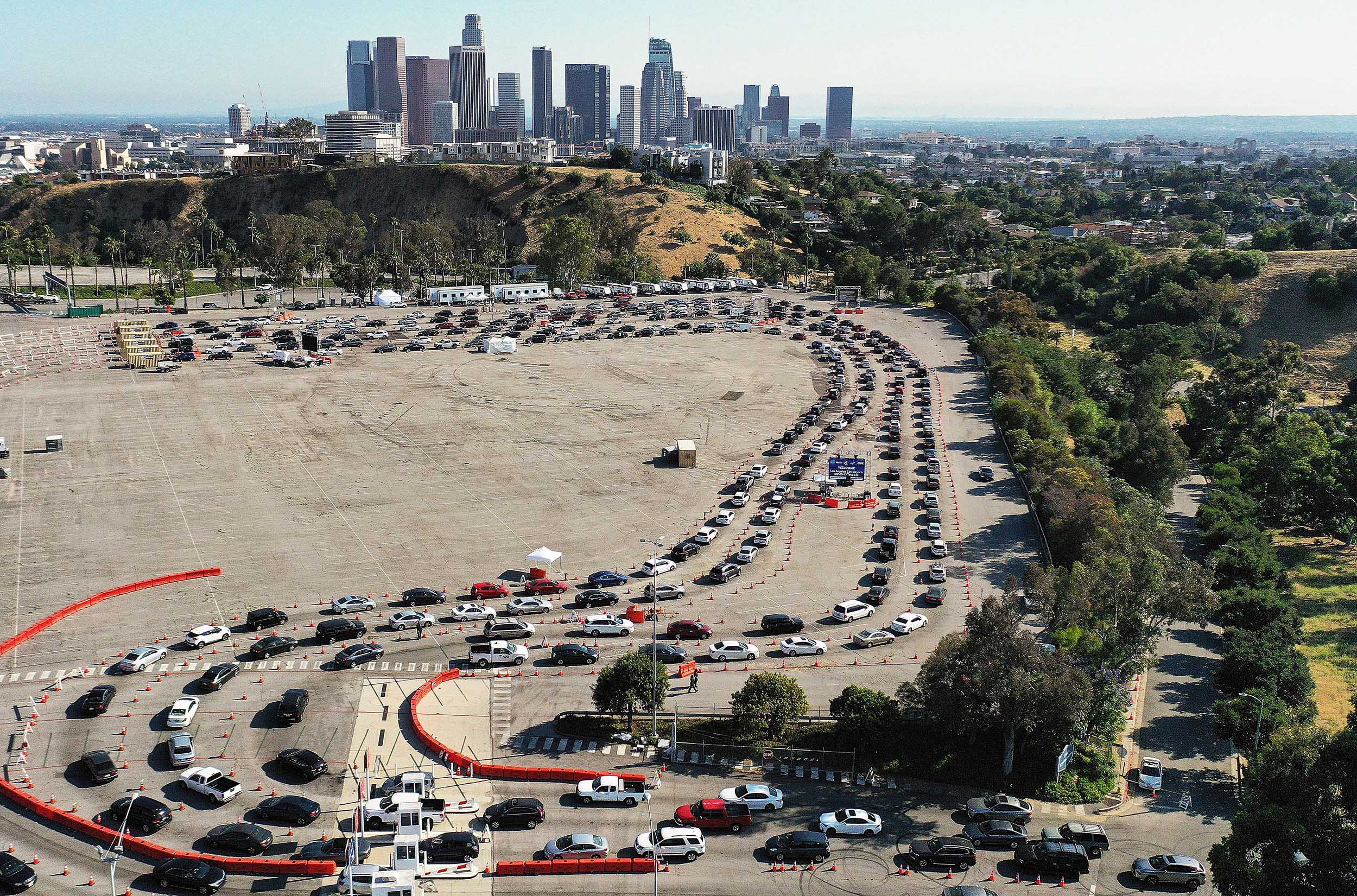 An aerial view of people in cars lined up to be tested for COVID-19 at Dodger Stadium amid the coronavirus pandemic on June 26, in Los Angeles, California.