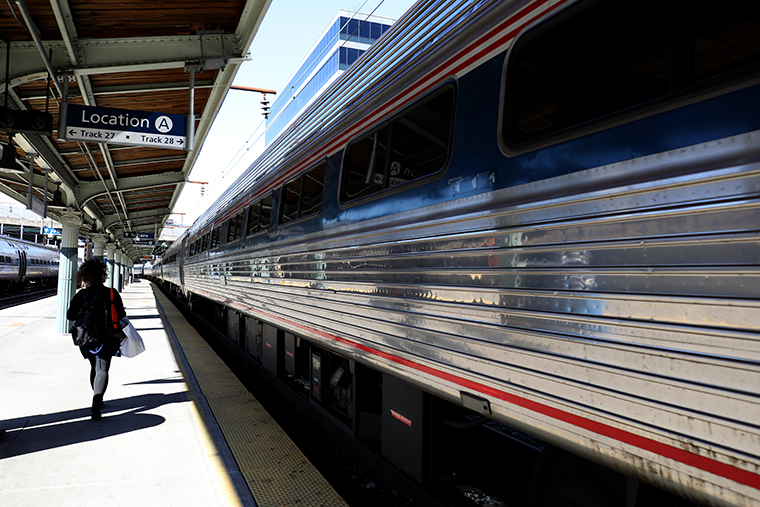 A passenger walks to a departing Amtrak train at Union Station on April 09, 2020 in Washington, D.C.