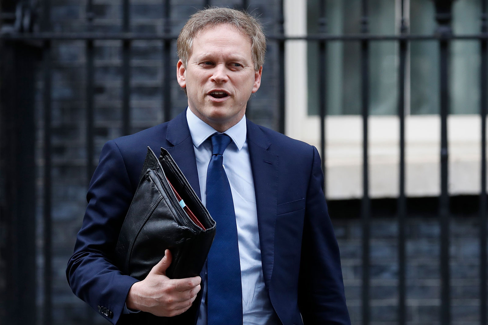 Britain's Transport Secretary Grant Shapps leaves number 10, Downing Street in central London on March 17.