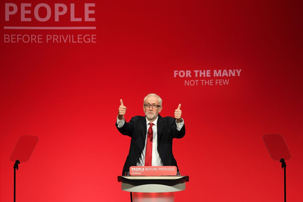 Jeremy Corbyn acknowledges applause at the start of his speech.