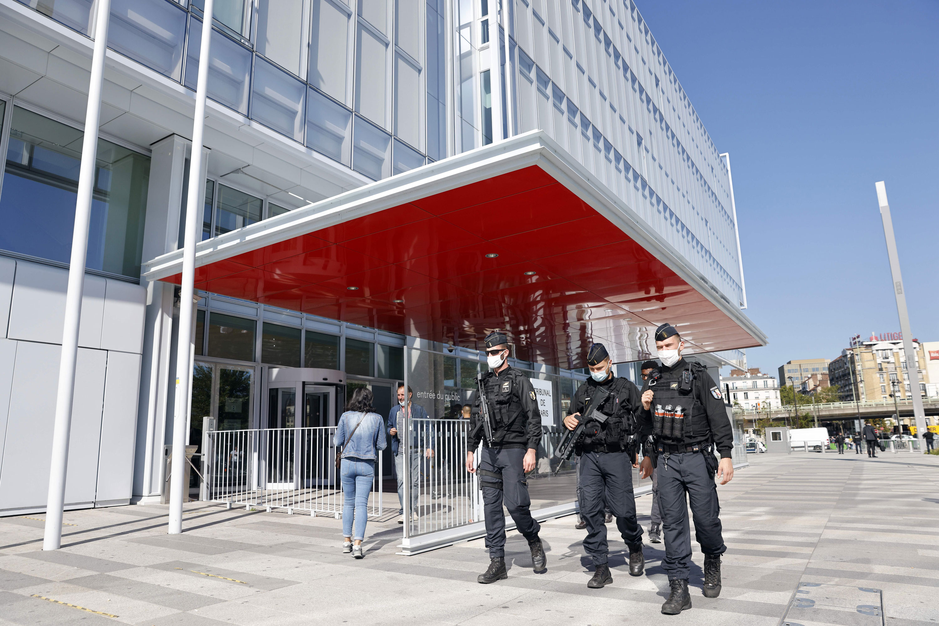 Police officers patrol outside Paris' courthouse, on September 2, the opening day of the trial of 14 suspected accomplices in the Charlie Hebdo attack.