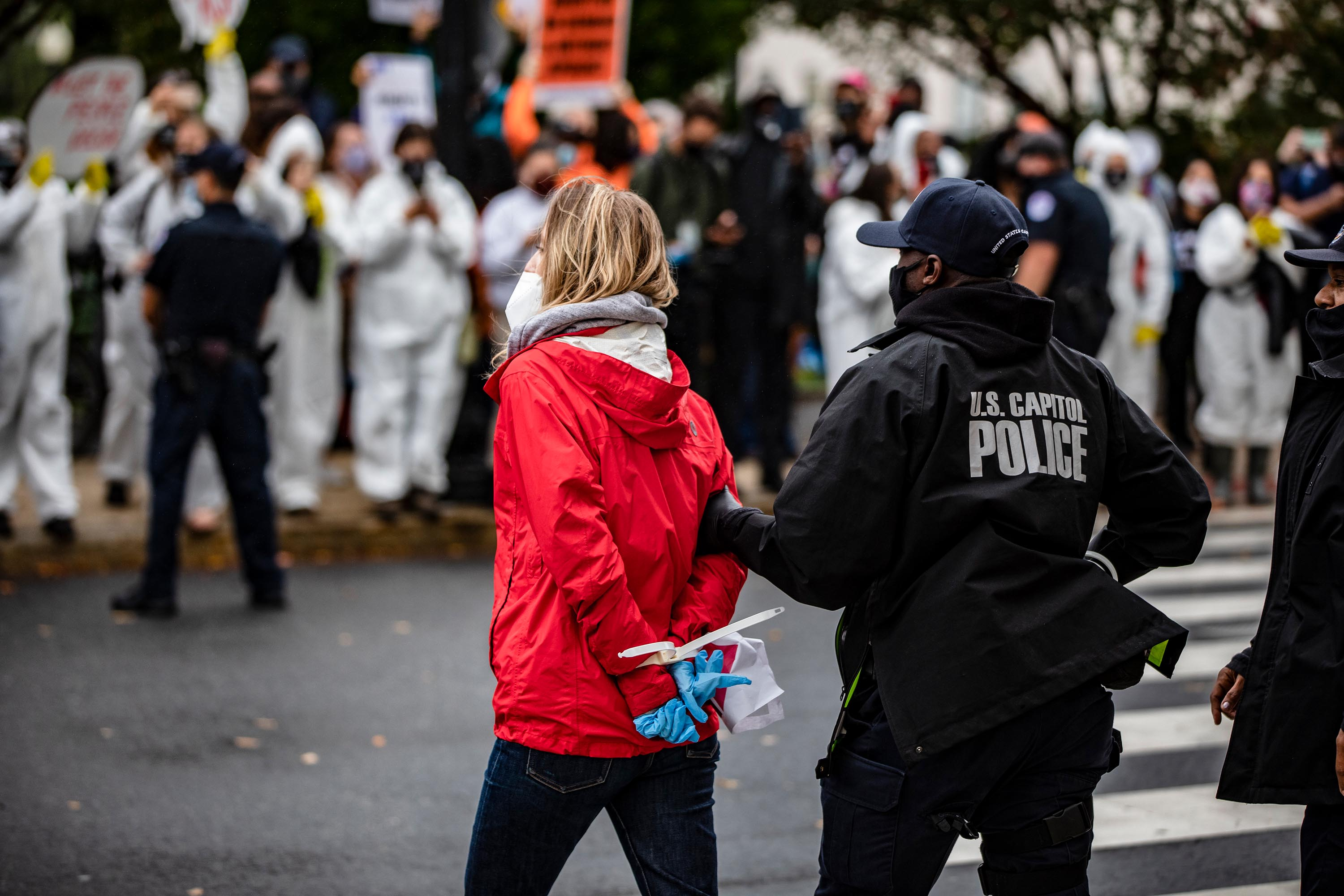 A protestor is arrested by Capitol Police after blocking an entrance to the Dirksen Senate Office Building the morning that the confirmation hearings begin for Judge Amy Coney Barrett on Capitol Hill on Monday.