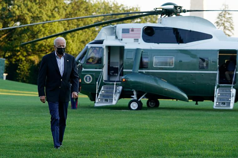President Joe Biden walks across the South Lawn of the White House in Washington, Tuesday, Sept. 7, 2021.