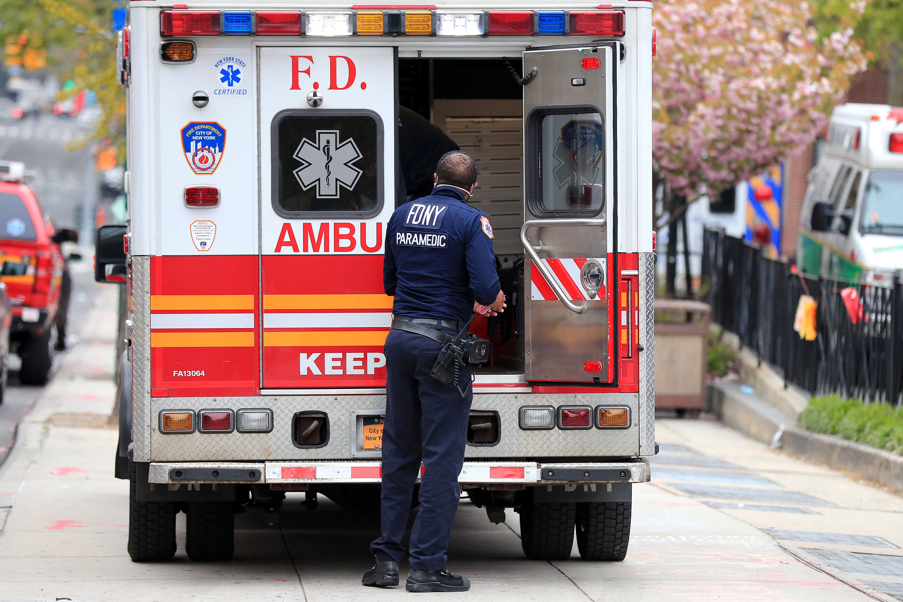 A FDNY paramedic unloads a patient from an ambulance near the Emergency Room entrance to the Brooklyn Hospital Center on April 23 in New York City.