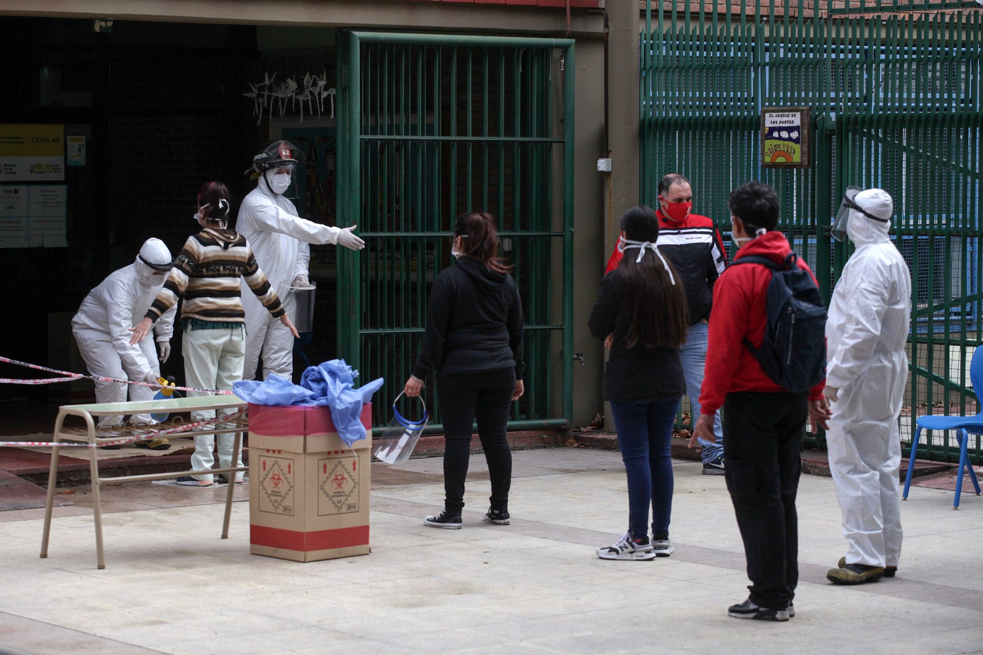 Members of Plan DETECT operation test people in the Palermo neighborhood for symptoms compatible with COVID-19 in Buenos Aires on June 24.