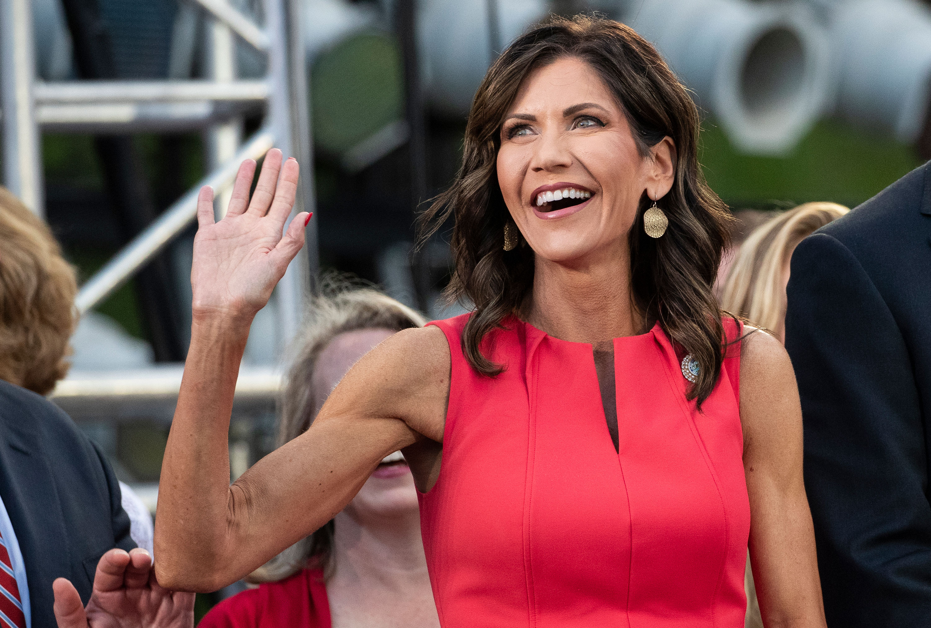 South Dakota Gov. Kristi Noem waves to supporters at Mount Rushmore National Memorial, FridaJuly 3, 2020, near Keystone, South Dakota.