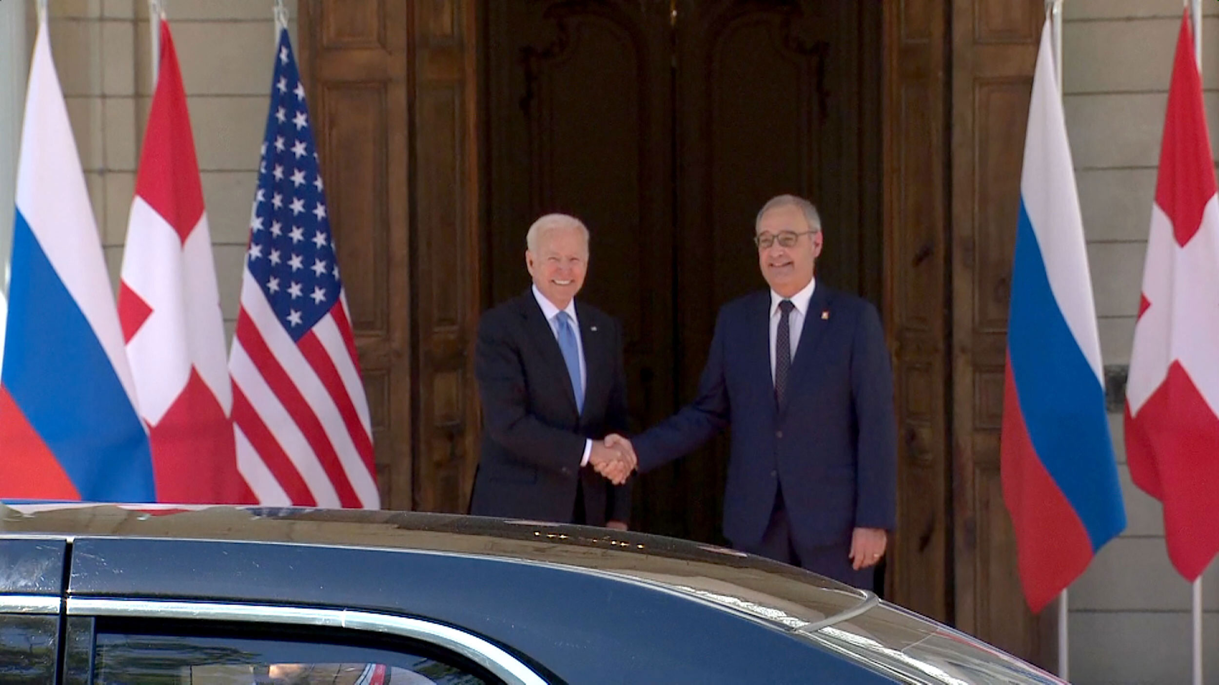 President Joe Biden is greeted to the summit site by Swiss President Guy Parmelin.