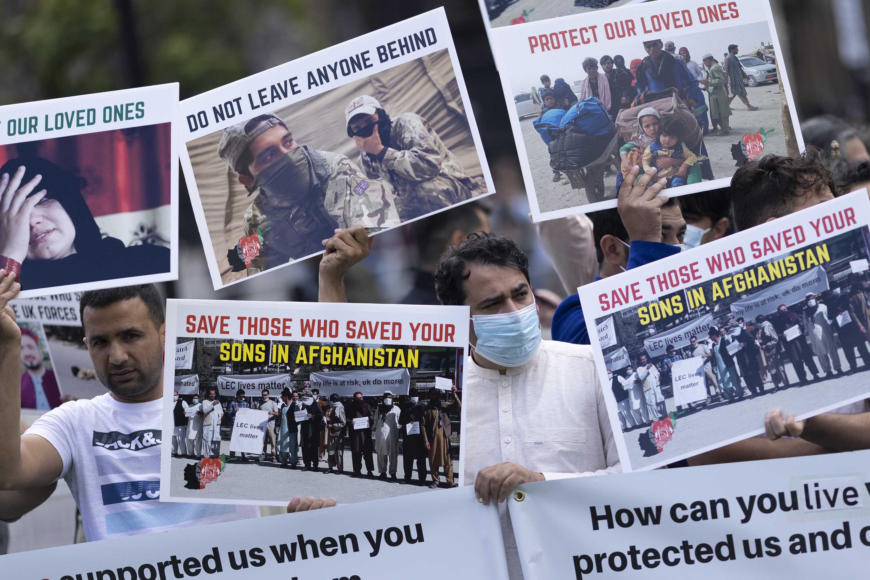 A group of former interpreters for the British and allied forces in Afghanistan protest at Parliament Square in London, on Wednesday, August 18.