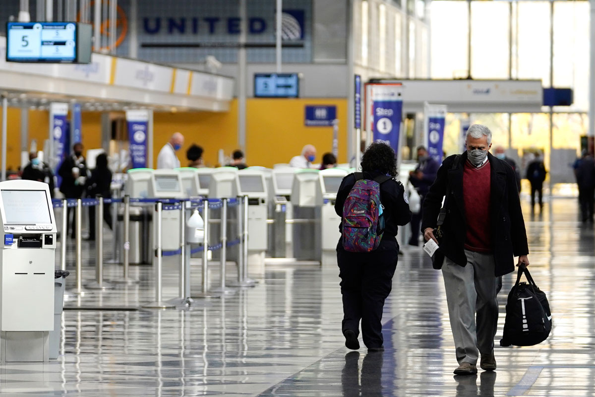 Travelers walk through Terminal 1 at O'Hare International Airport in Chicago, on October 14.