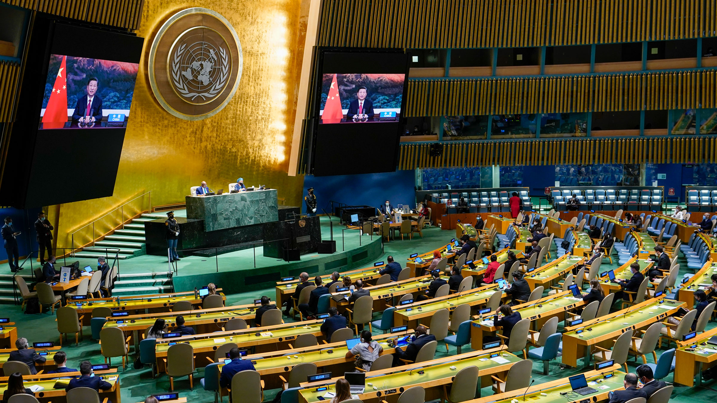 Chinese President Xi Jinping is seen on a video screen as he addresses the General Assembly on Tuesday.