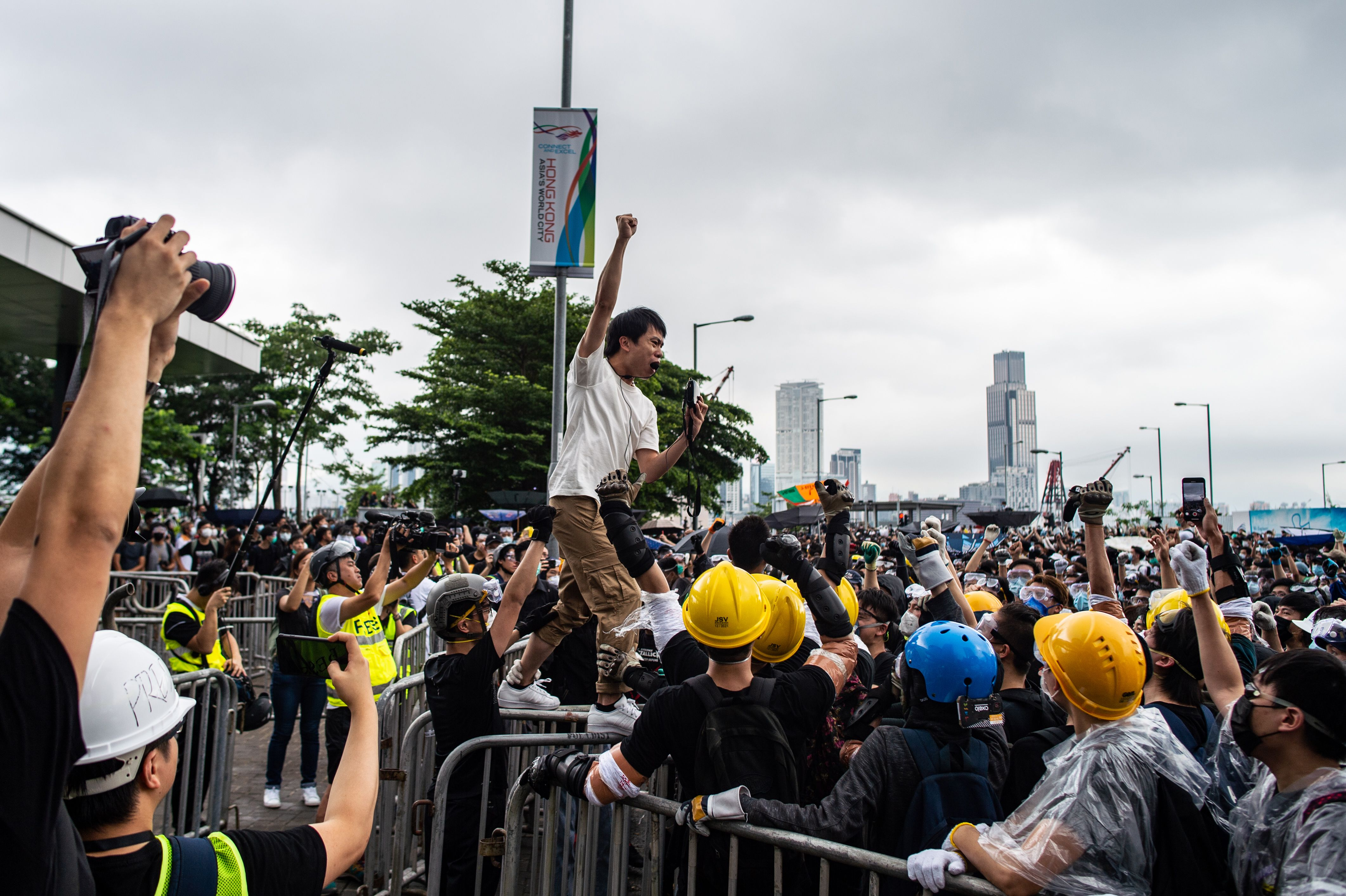 Pro-democracy lawmaker Roy Kwong chants slogans as protesters occupy outside Legislative Council.